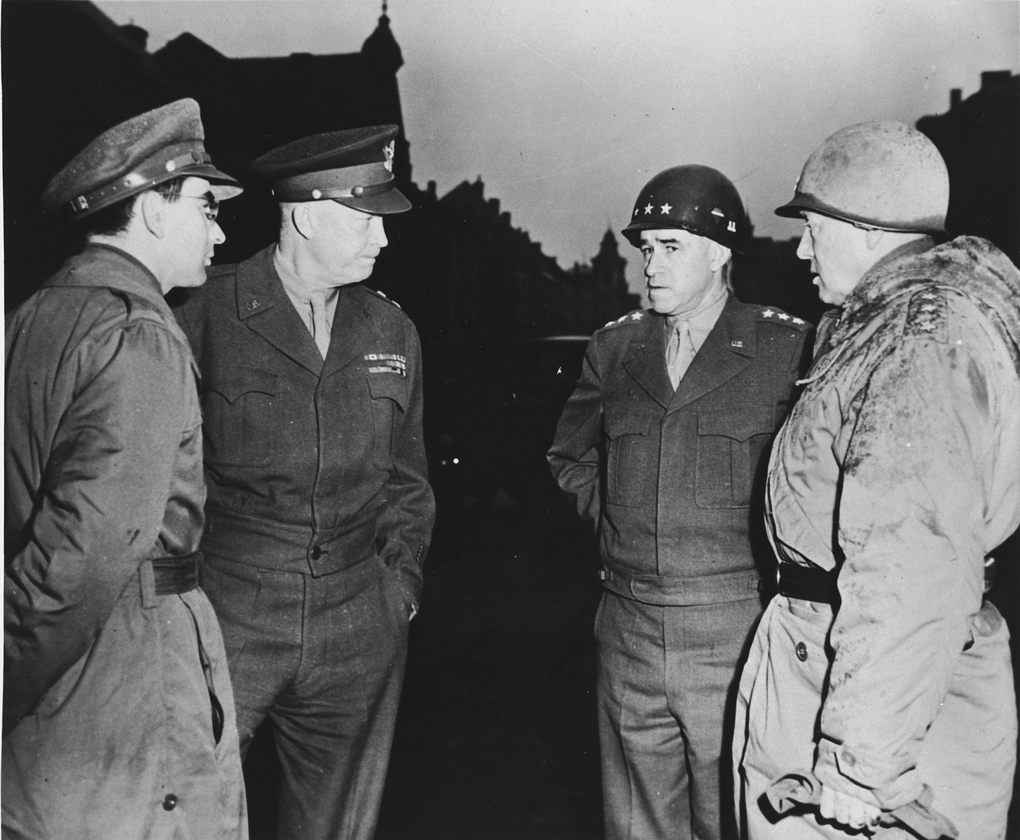 "High-ranking U.S. Army officers visit the ruins of Bastogne.  From left to right are Sgt. Jules Grad, correspondent for the newspaper, ""Stars and Stripes"", Gen. Dwight D. Eisenhower, Lt. Gen. Omar K. Bradley and Lt. Gen. George S. Patton."