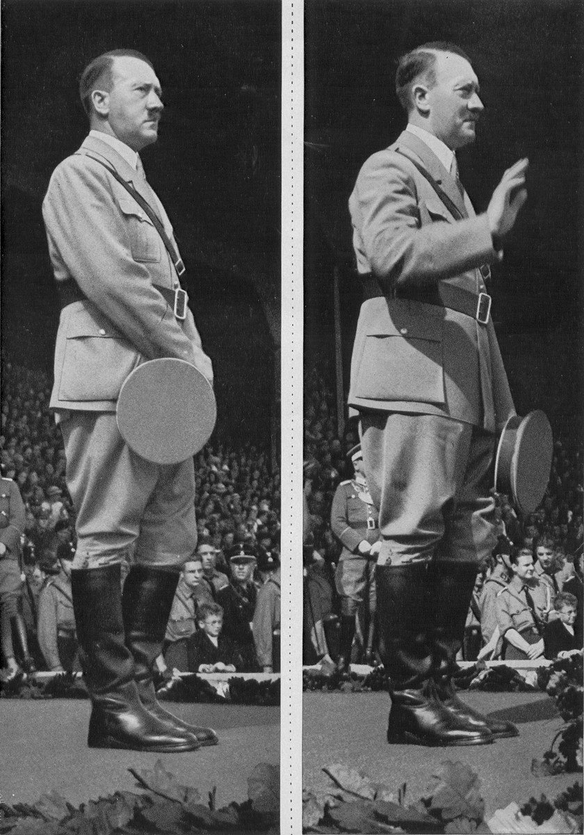 Chancellor Adolf Hitler stands on the podium before a crowd of youth during a Reichsparteitag (Reich Party Day) ceremony in Nuremberg.