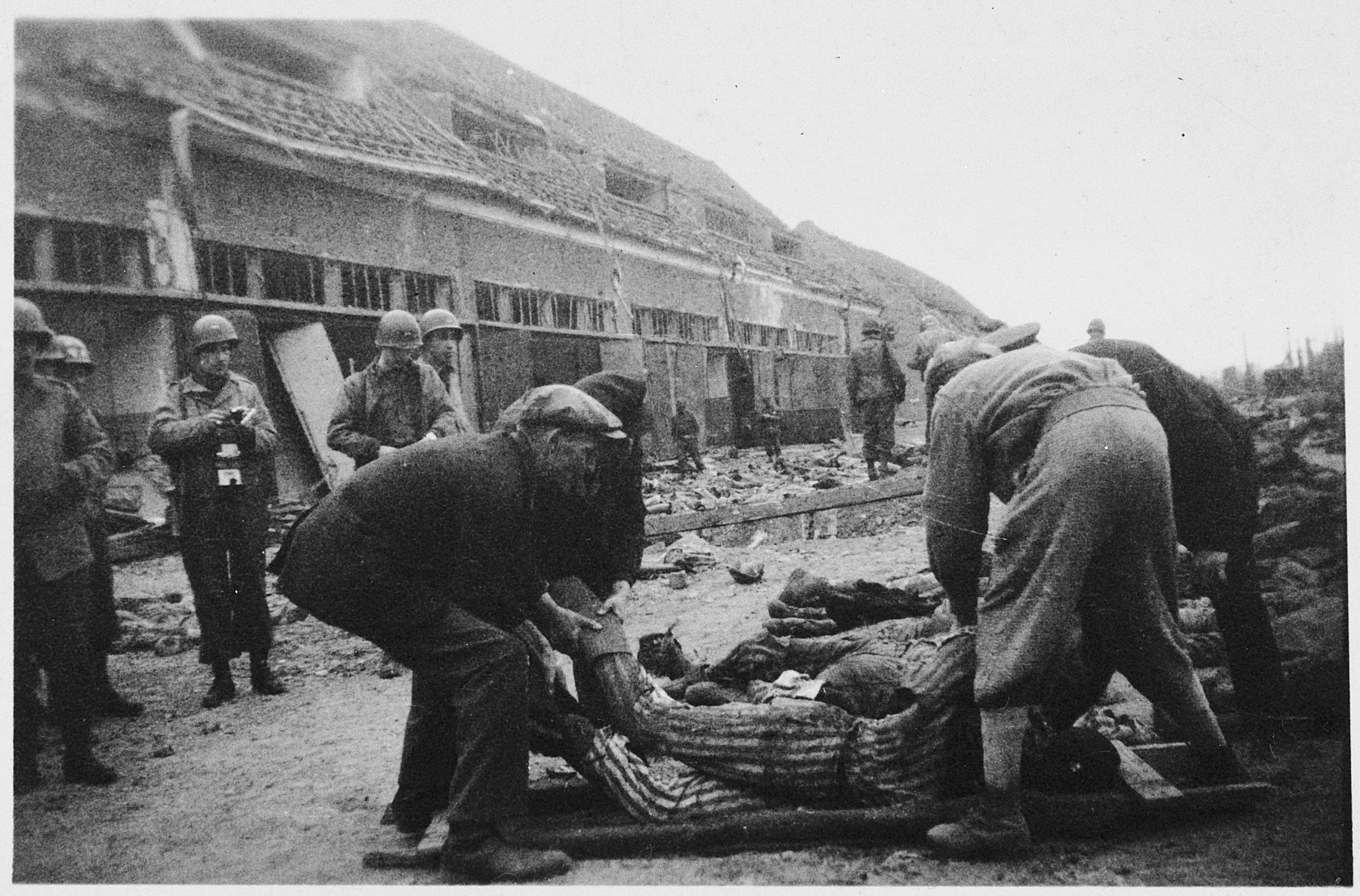 American soldiers oversee German civilians forced to clear away corpses in the Nordhausen concentration camp.
