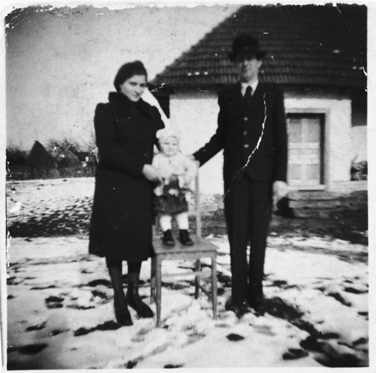 Portrait of a couple and their one-year old child taken in Hungarian occupied Romania shortly before they were forced into a ghetto.  Pictured are the family of the donor's sister: Hershel, Esther (nee Pollack) and Miriam.  All were later killed in Auschwitz.
