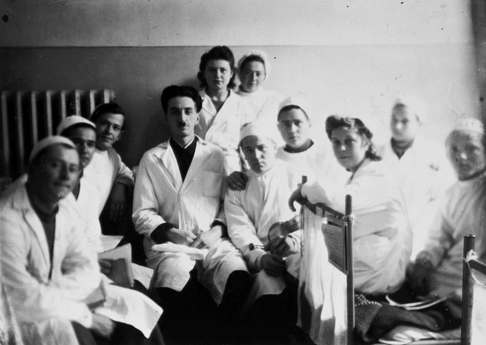 Group portrait of medical students from Kiev University in its temporary location in the Ural Mountains.  Yulian Rafes is in the center (fourth from the left).