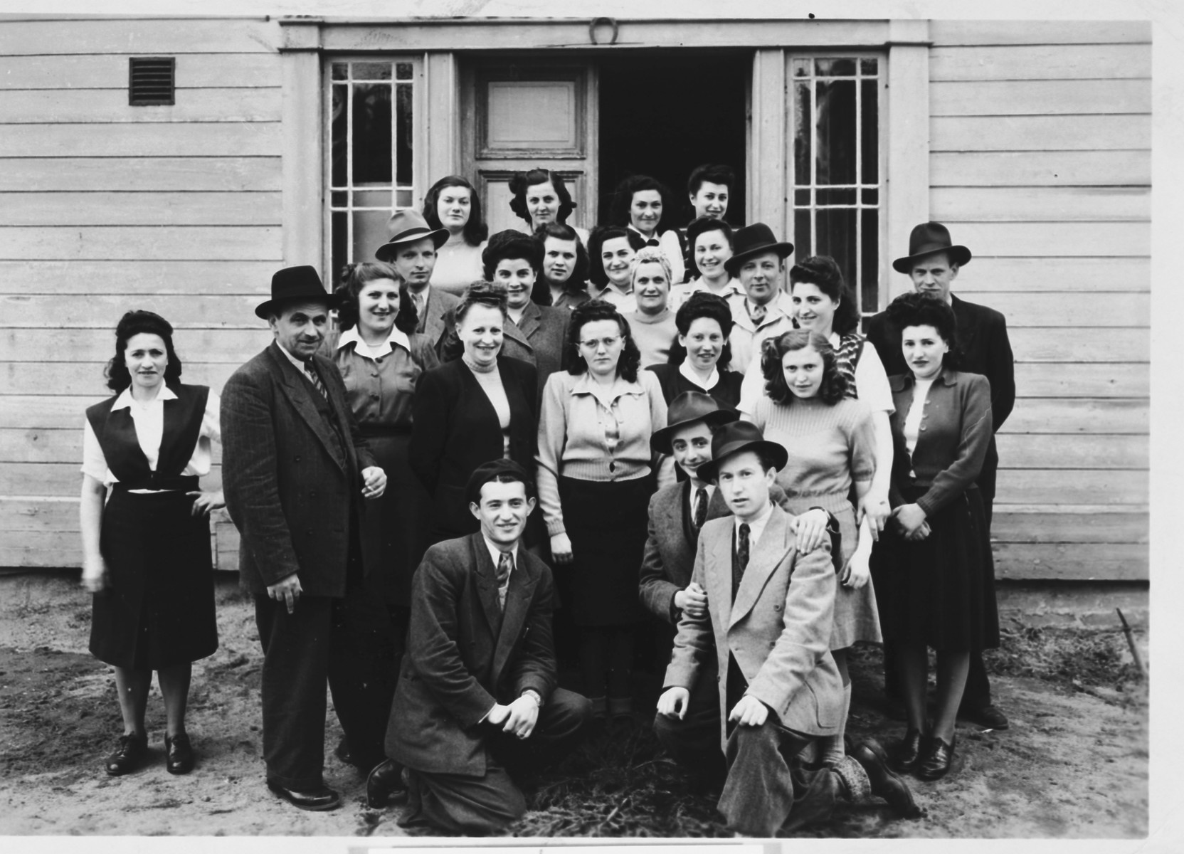 Group portrait of religious Jewish displaced persons in Sweden.  Regina Pollack is pictured in the third row, second from the right.