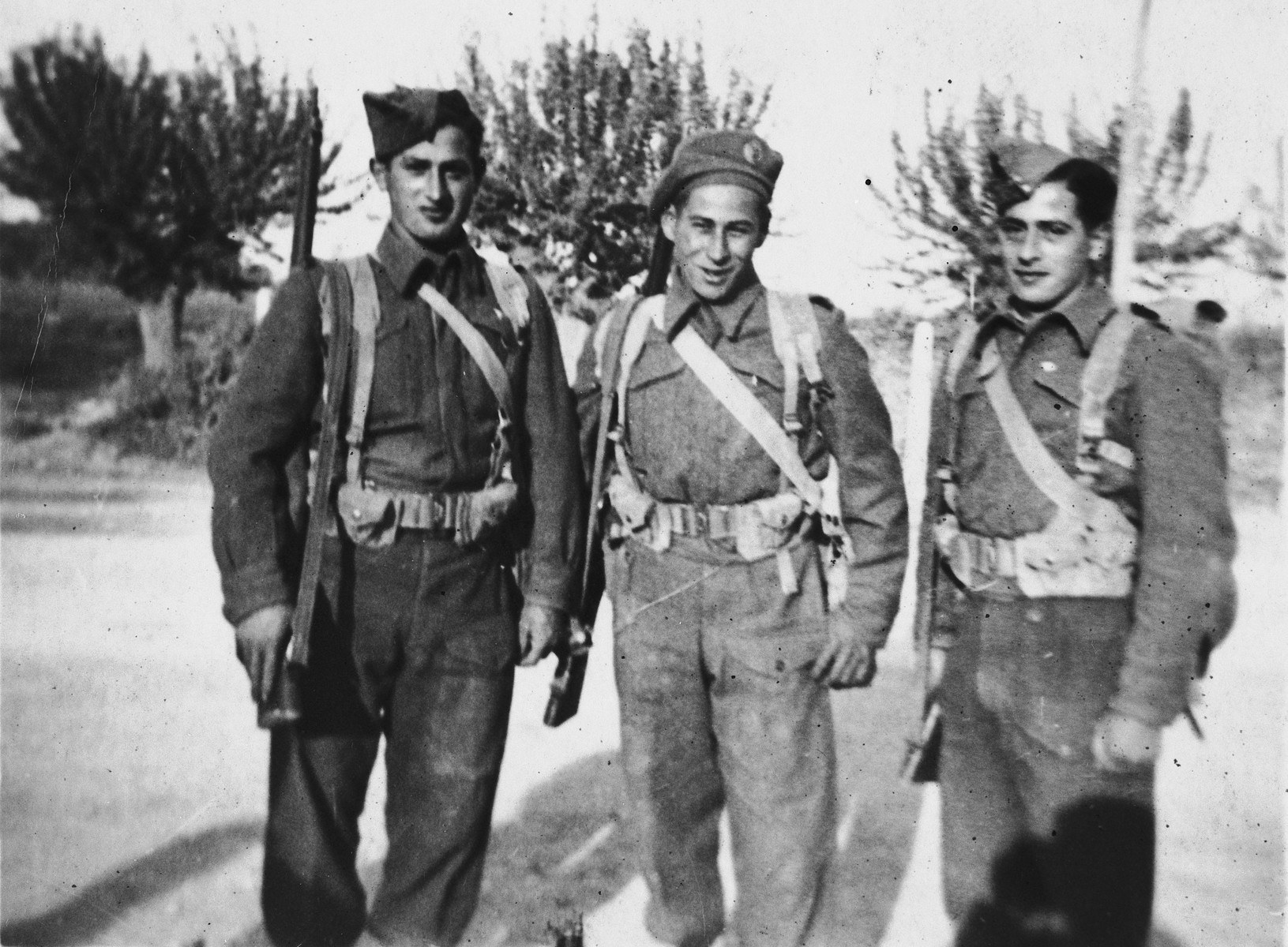 Three members of the Jewish Brigade and members of the British 8th Army pose on a street in Italy.  Samuel Zajac is on the far left.  His brother Felix is on the right.