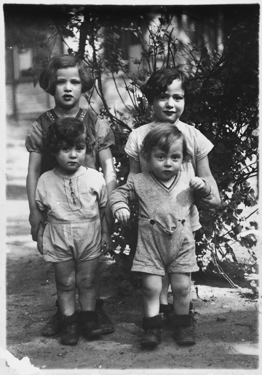 The four youngest Zajac children pose together in a garden.  Hella and Hermann are in front.  Henni and Joseph stand behind them.