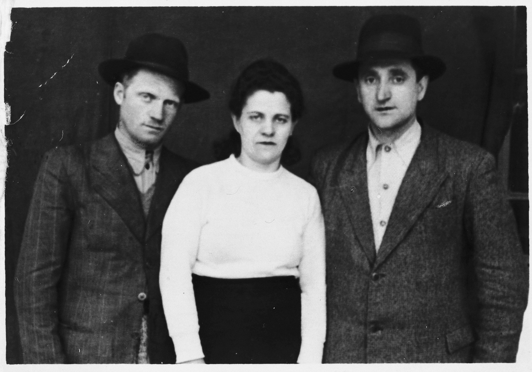 Portrait of three members an Orthodox Romanian family taken on the eve of World War II.  Pictured from the right are Moshe David Pollack, his wife Lotte, and his brother Shmuel Eli.