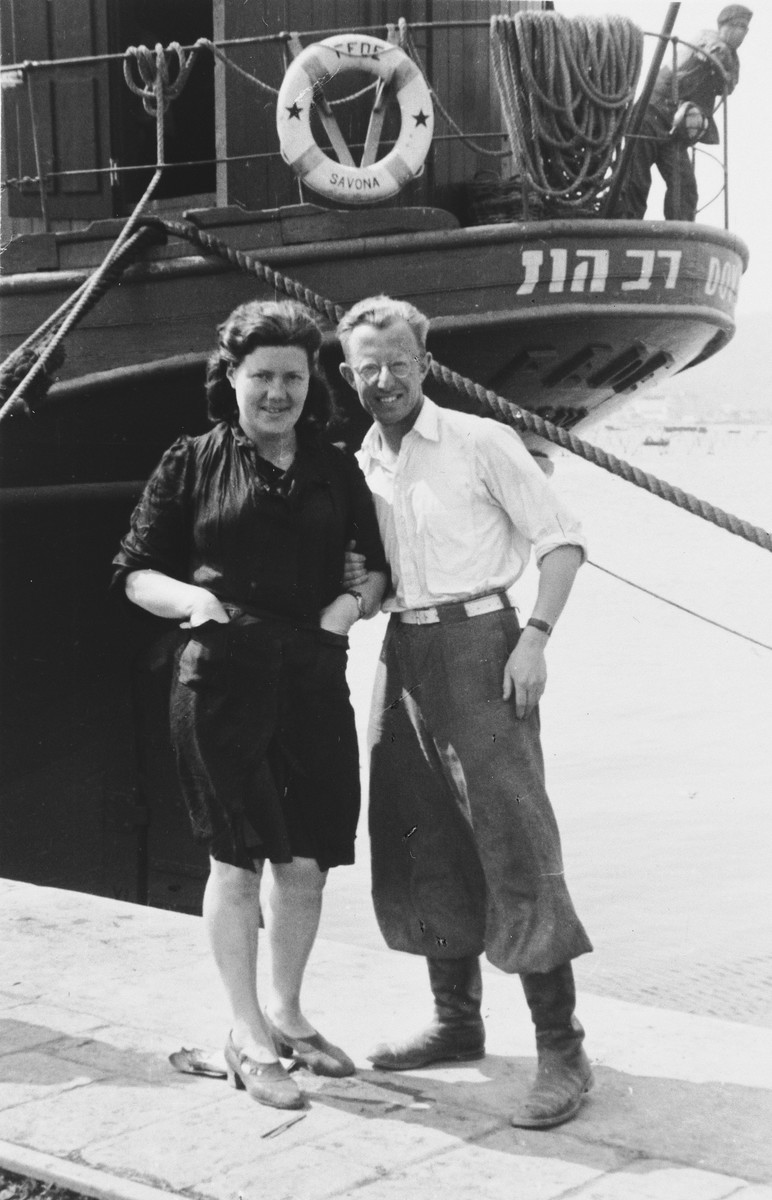 Two Jewish DPs pose in front of the immigrant ship Dov Hos at the port of the La Spezia.