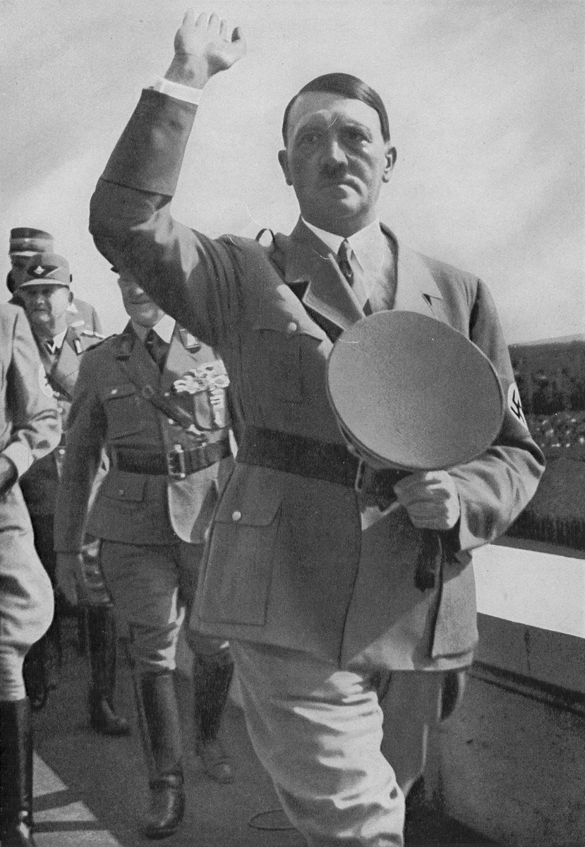 Chancellor Adolf Hitler salutes the crowd assembled in the Zeppelinfeld at Reichsparteitag (Reich Party Day) ceremonies in Nuremberg.