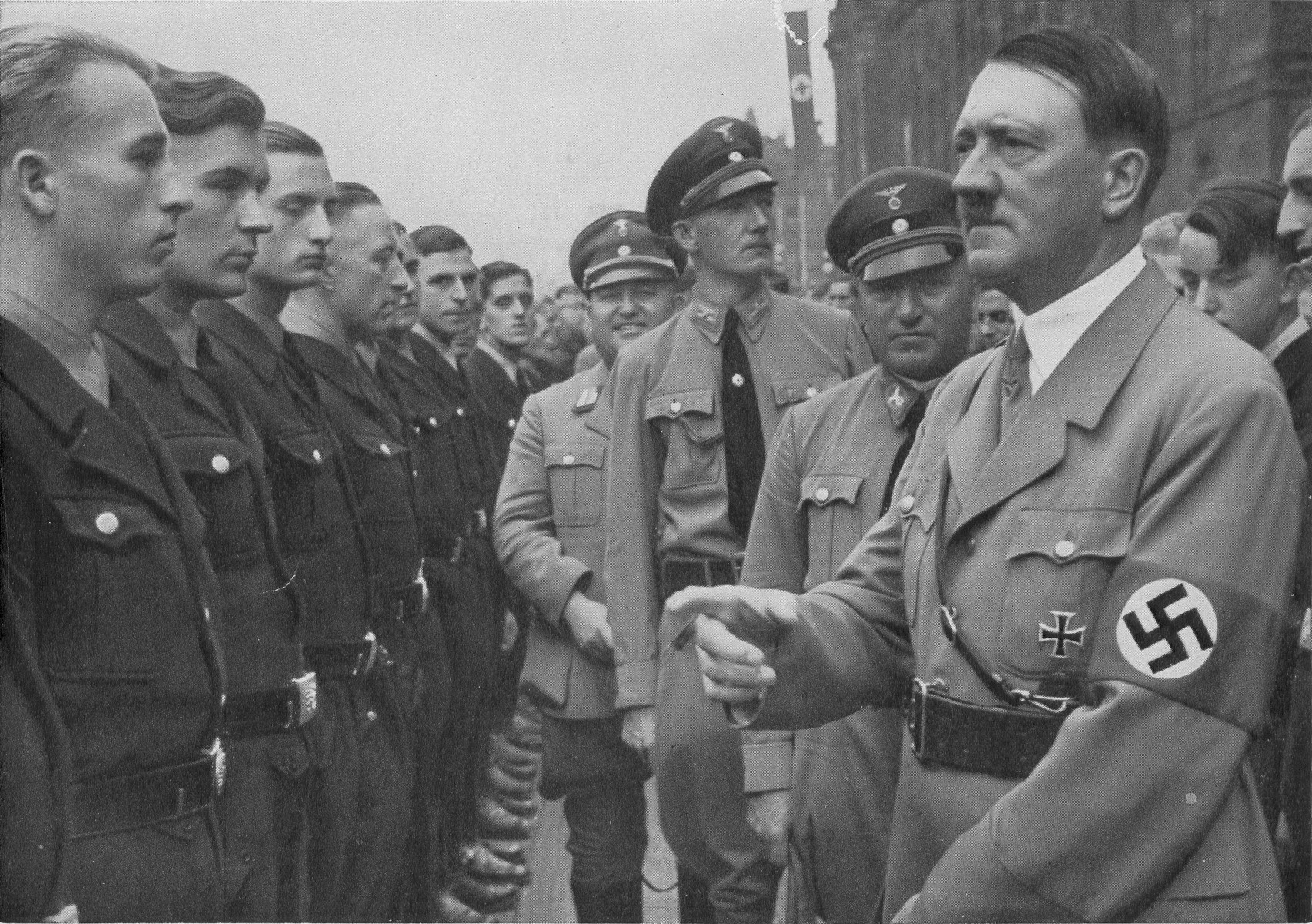 Adolf Hitler and Robert Ley review a unit of DAF (Deutsche Arbeitsfront) workers at Reichsparteitag (Reich Party Day) ceremonies in Nuremberg.