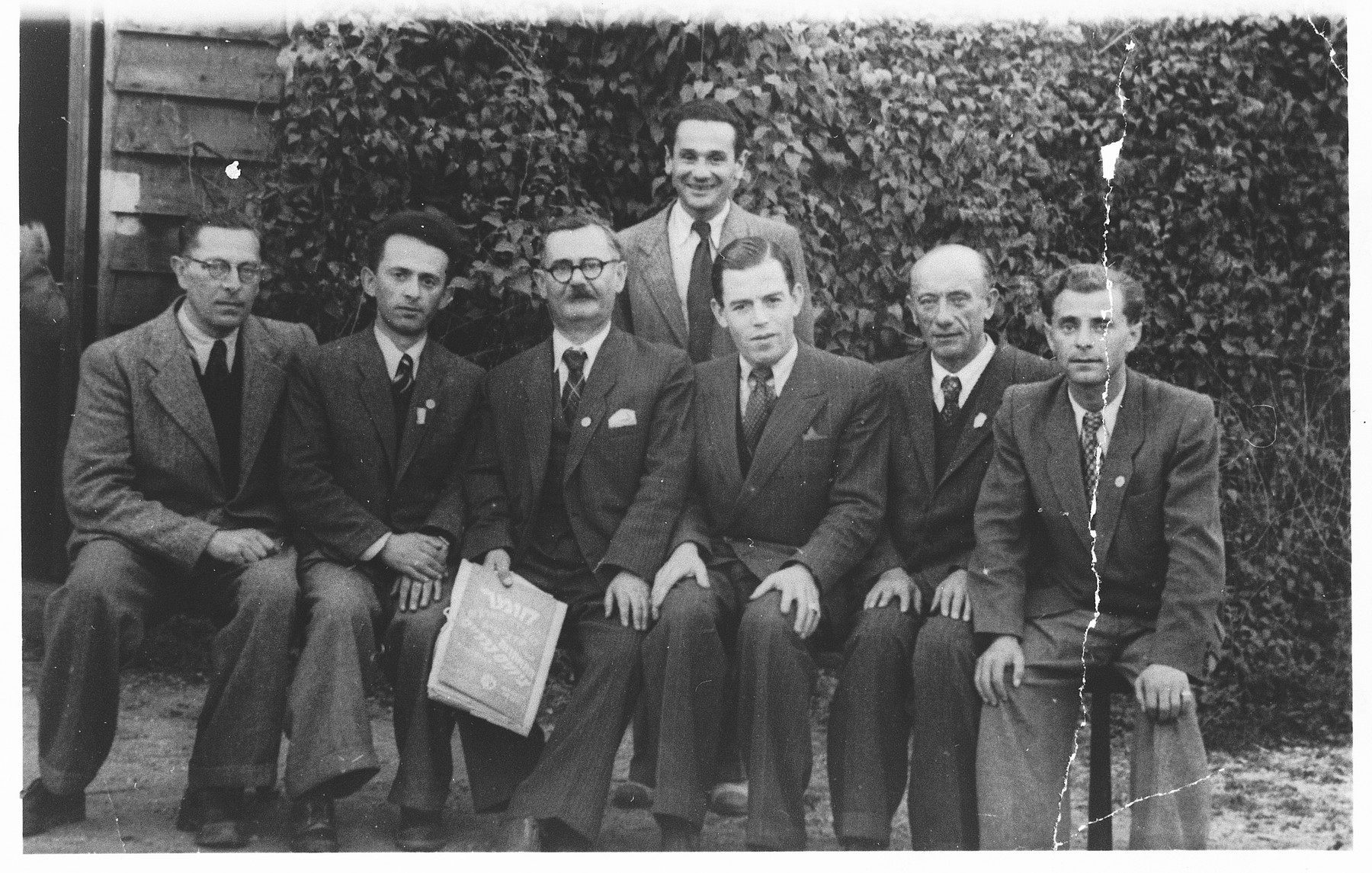 Members of the Wels displaced persons' camp presidium.  Seated second from right is Pinchos Wagner, head of the camp post office.