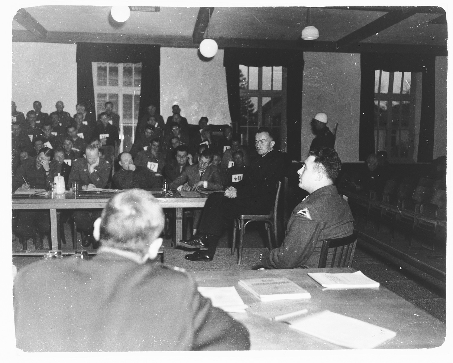 Attorneys listen to testimony during the Dachau concentration camp trial.