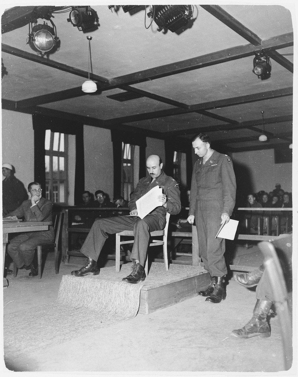 Prosecutor William Denson and another of the American team examine documents during the Dachau trial.
