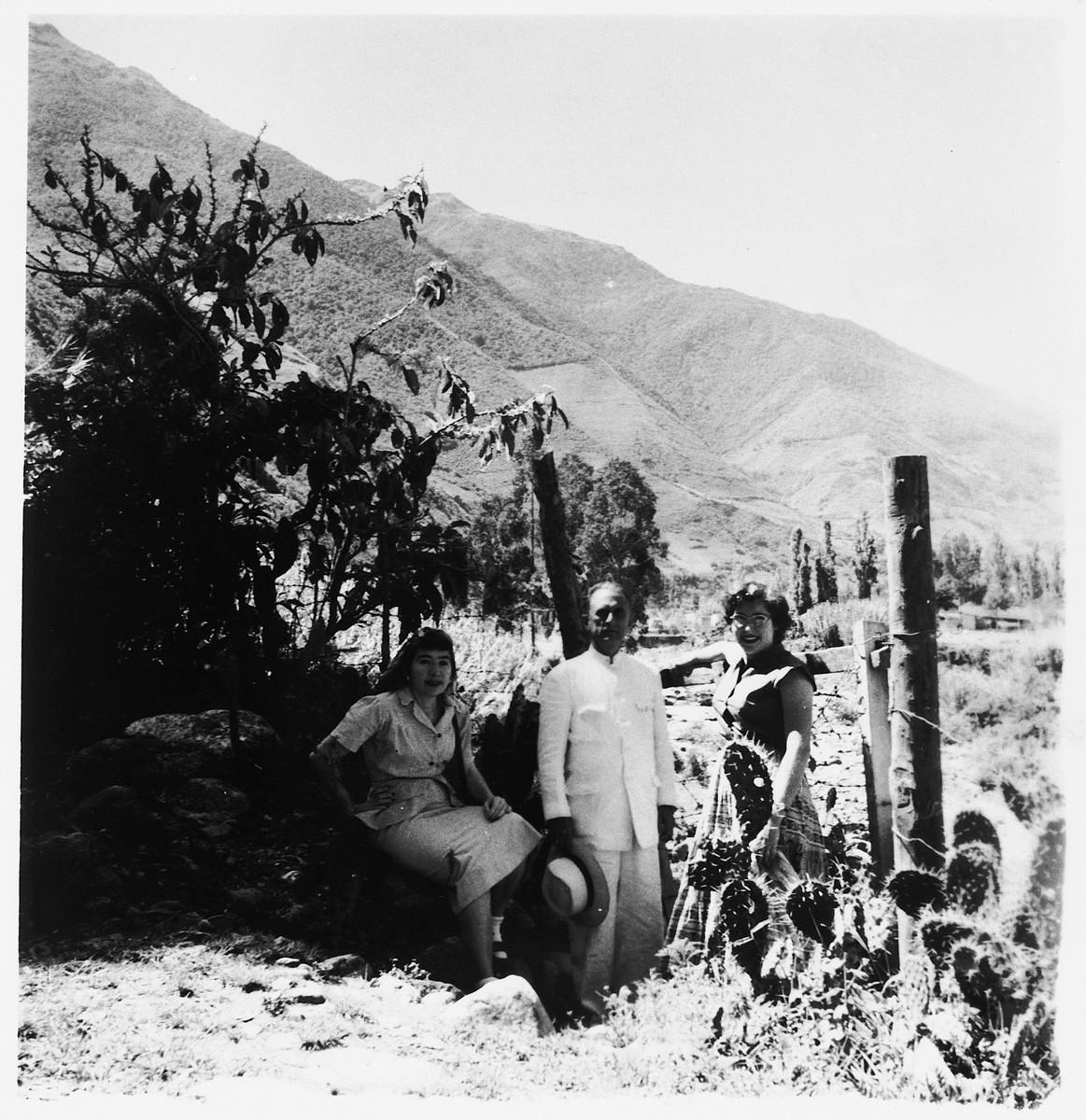 Three Jewish immigrants to Venezuela pose in a cactus field.