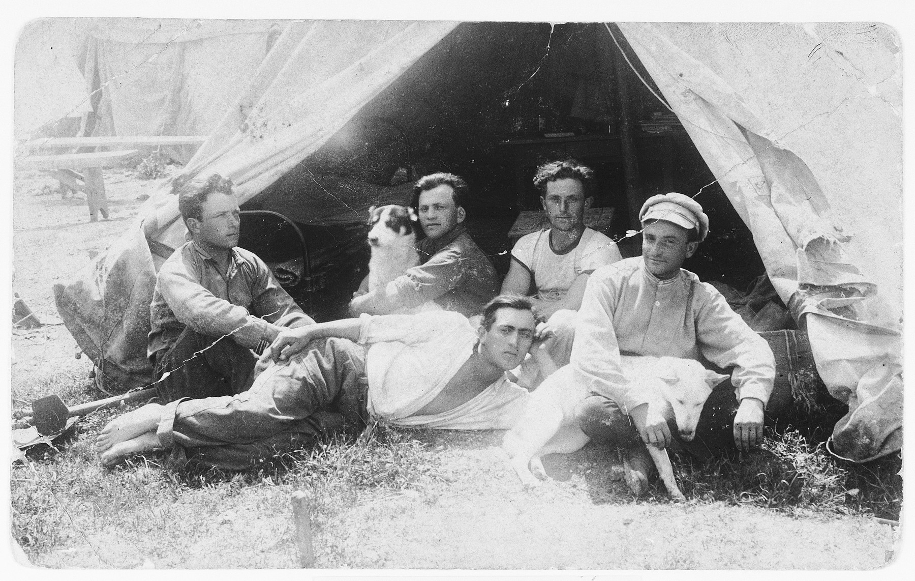 New pioneers pose next to their tent in a kibbutz in Palestine.  Among those pictured is Avraham Wagner.