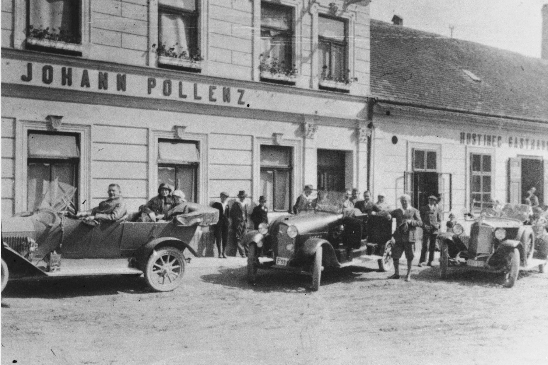 People gather outside the store of Johann Pollenz.