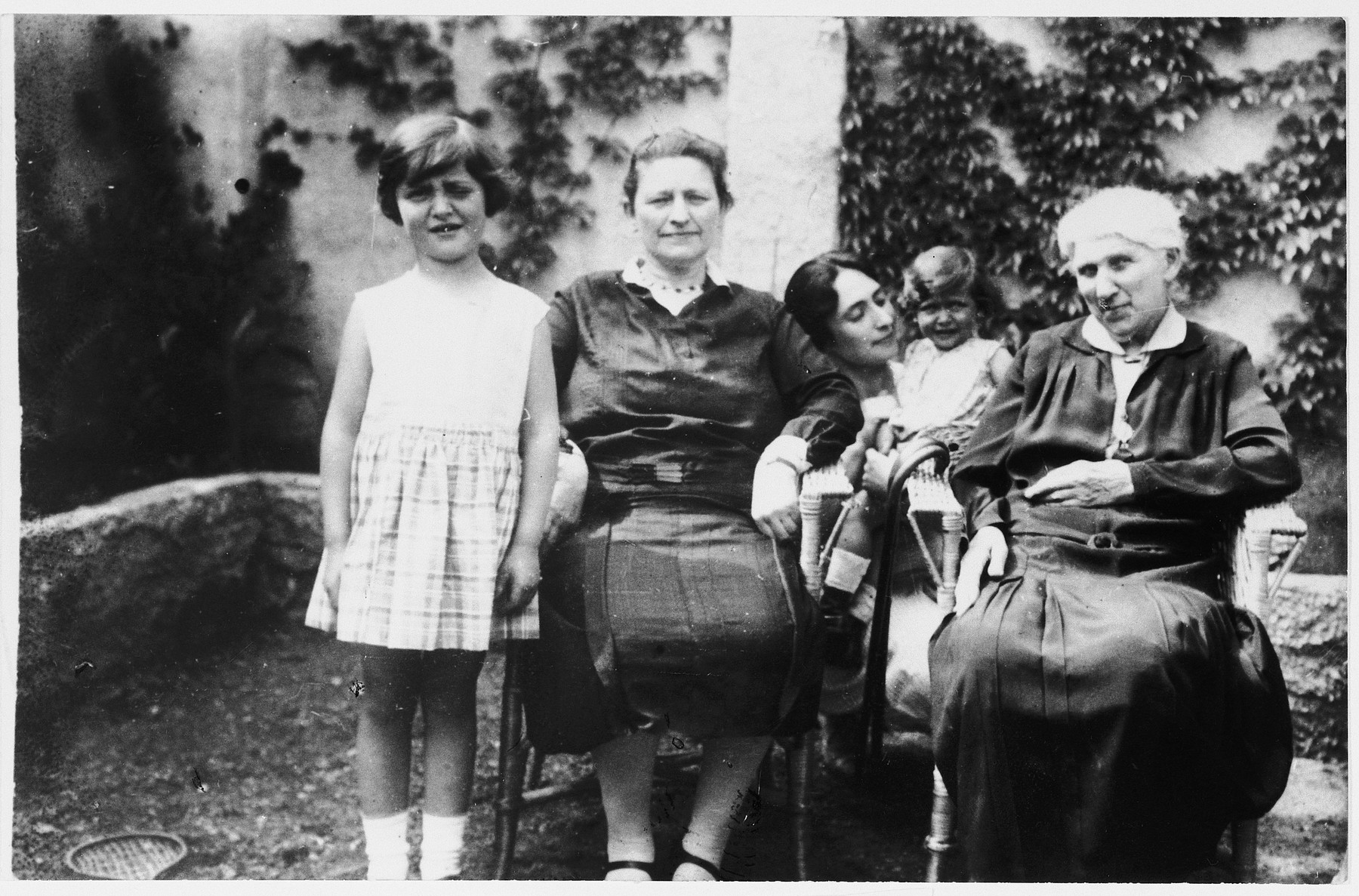Portrait of four generations of Czech-Jewish women.  From left to right are Eva Bermann, Leopoldine Pollenz, Anny Bermann holding her baby daughter Doris, and Eva and Doris's great grandmother.