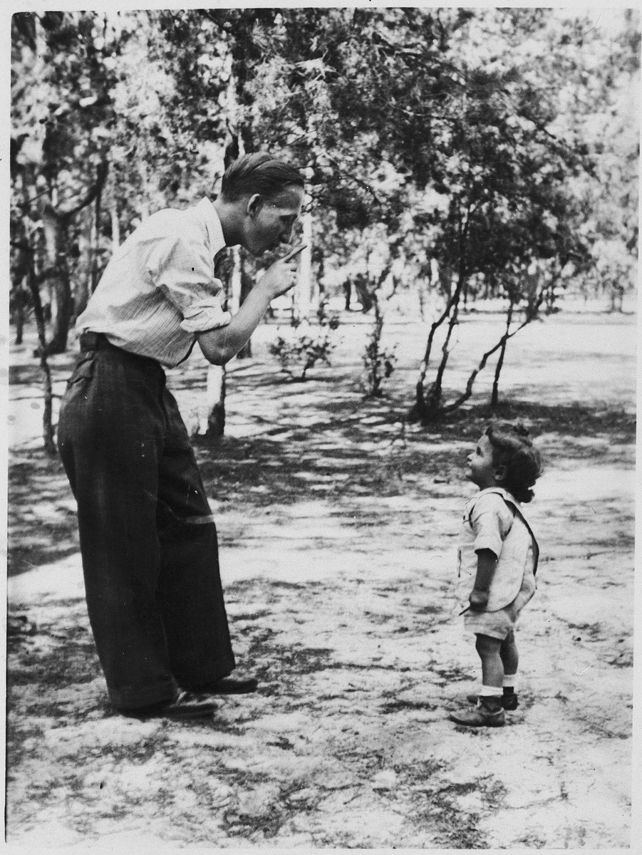 An uncle holds a playful conversation with his young nephew.  Pictured are Shlomo and Yosele Federman.