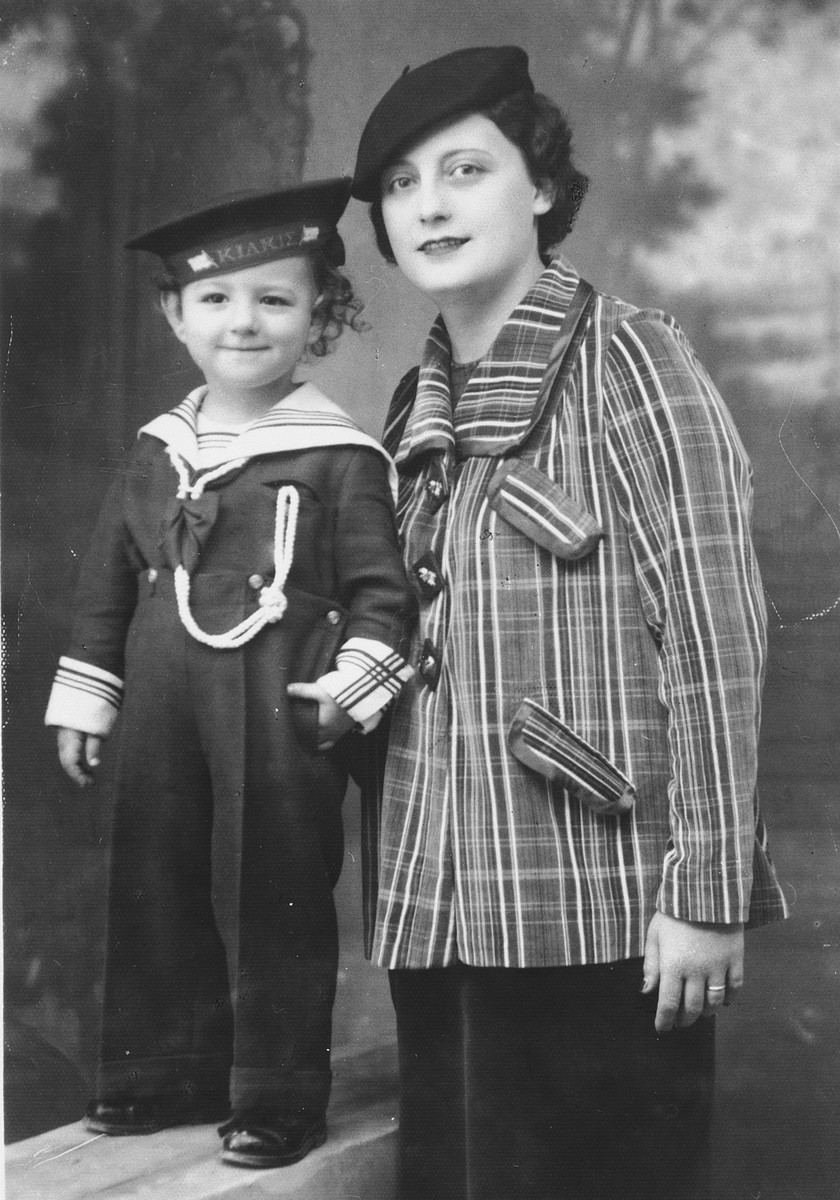 Studio portrait of Marie Torres and her younger daughter Dolly dressed in a sailor suit.