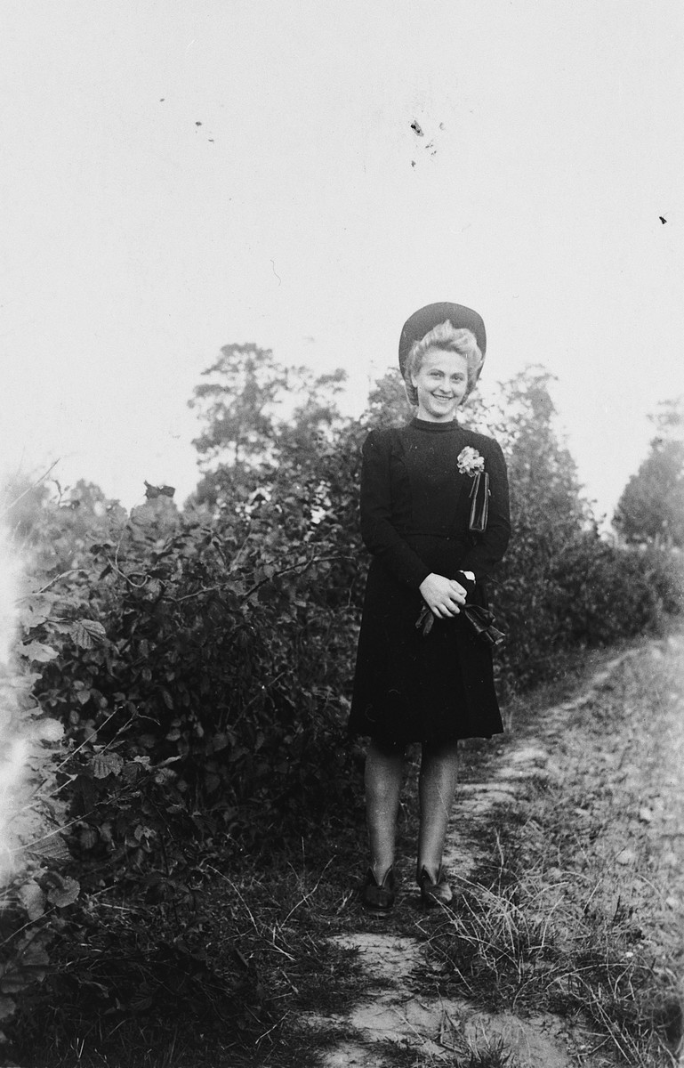A young Jewish woman poses outside while living in hiding as an ethnic German in Poland.  Pictured is Amalie Petranker.