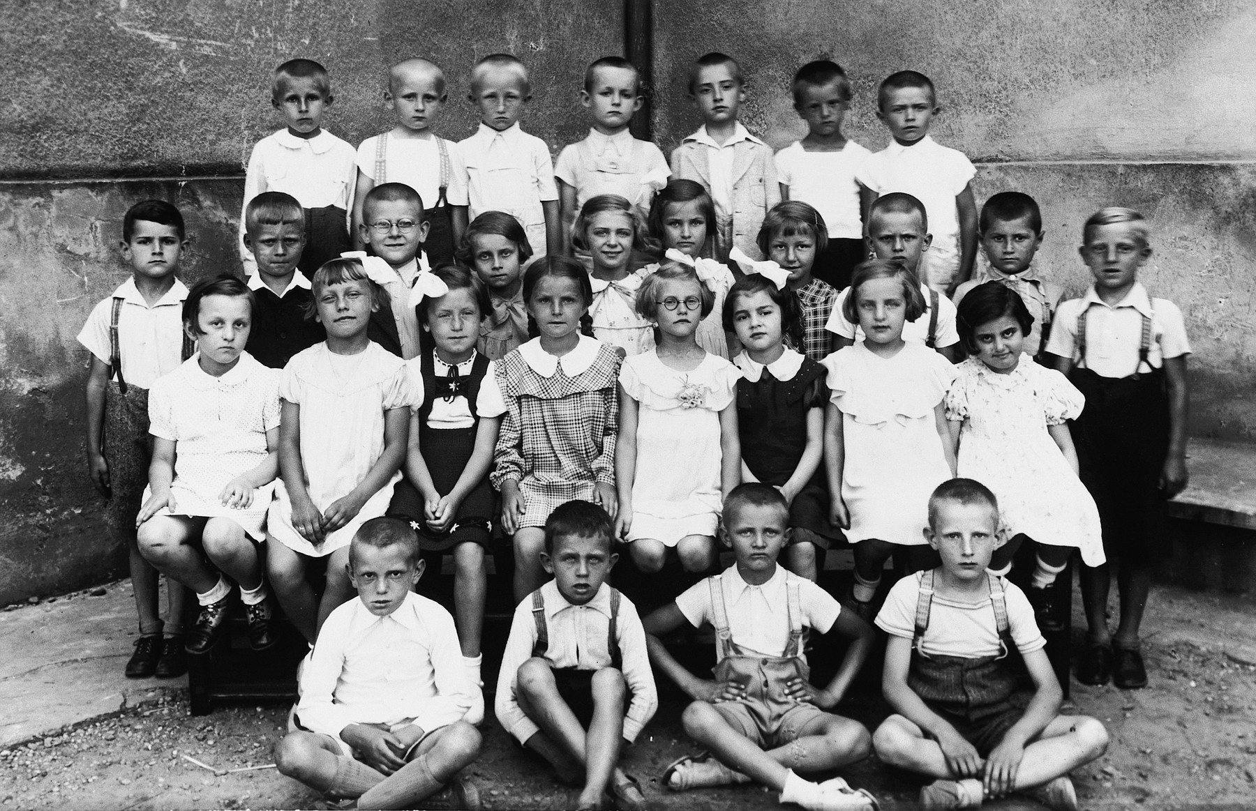 Class portrait of an elementary school in Bratislava.  Kitty Weichherz is sitting in the second row on the far right.  This photo was taken from the diary of Kitty's life written by her father, Bela Weichherz.