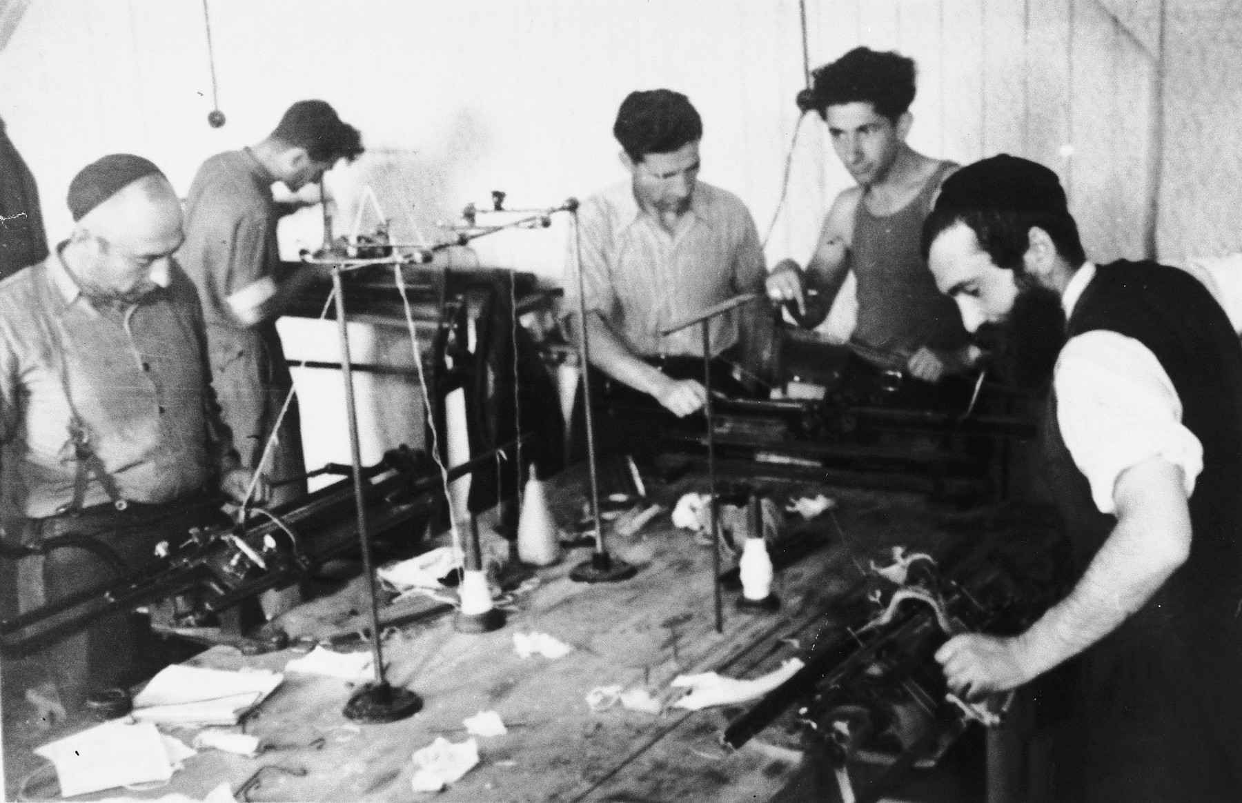 Men learn industrial knitting in an ORT vocational program in the Windsheim displaced persons' camp.  Among those pictured is Yidl Weinstein.