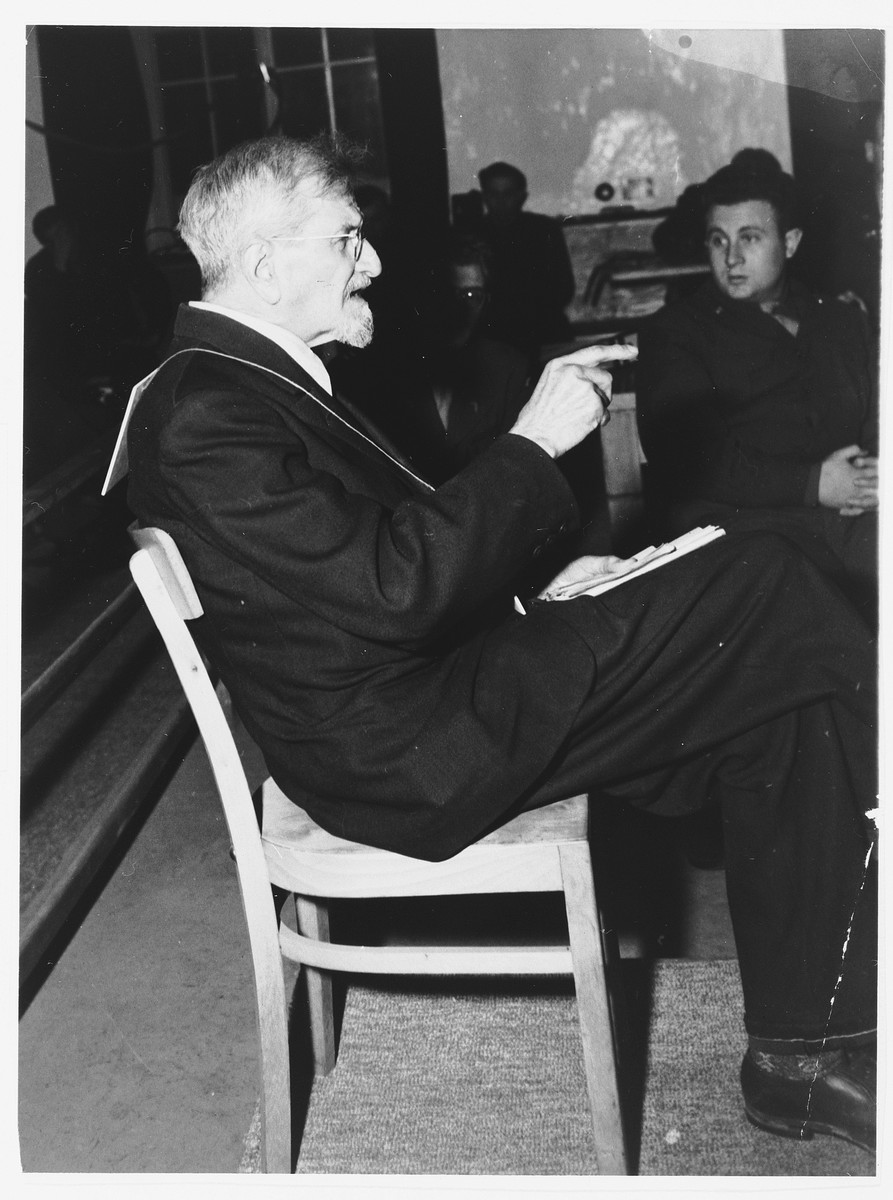 Defendant Dr. Klaus Schilling takes the stand in the Dachau trial.  He was responsible for performing malarial experiments on patients and was hanged in May 1946.