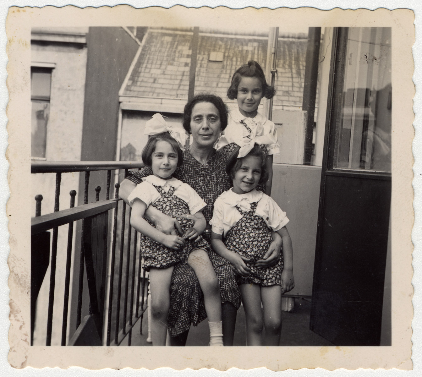 Three Jewish sisters pay a visit to their aunt prior to their departure for the United States.  Pictured are Karen, Renate and Marion Gumprecht and Beatrice Levi.  Beatrice Levi later perished in Riga.