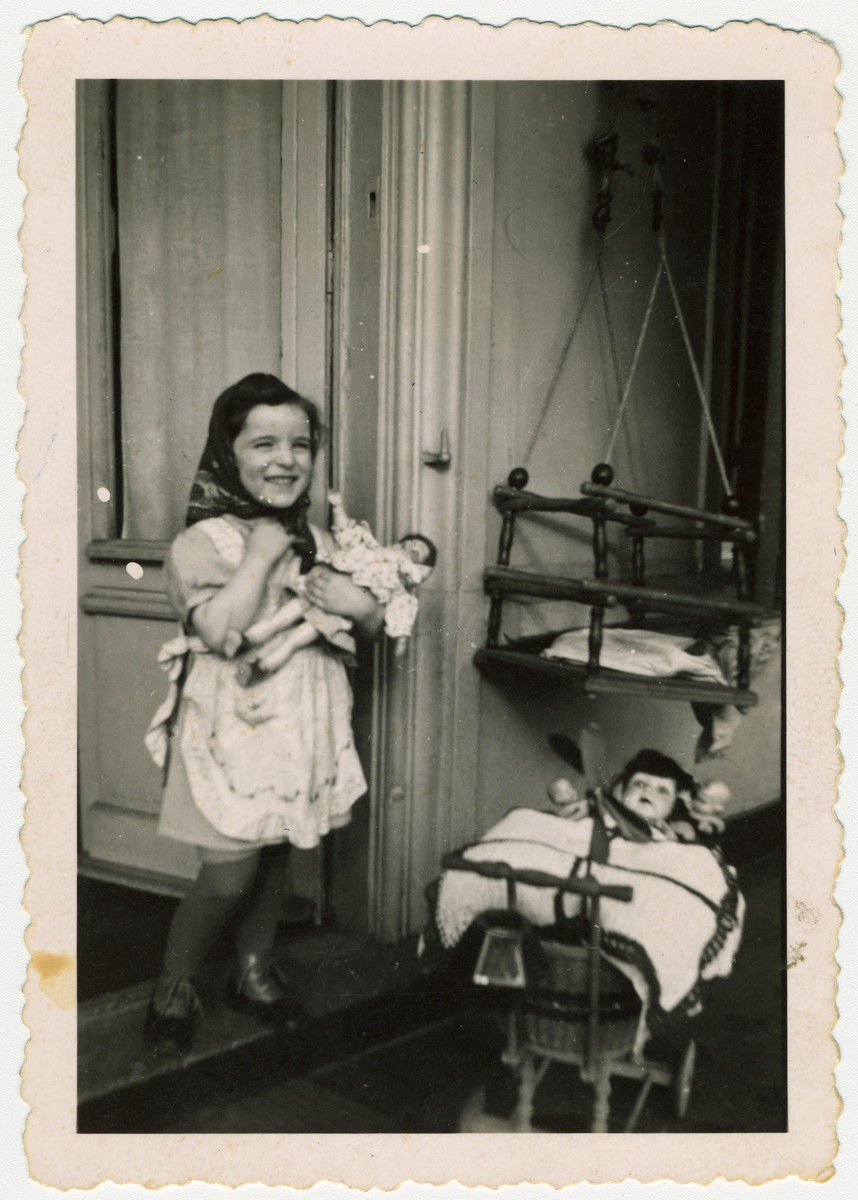 Myriam Manasse, a young German-Jewish girl plays with her dolls about a year before her deportation and murder.  The following year she was deported, presumably to Sobibor where she was killed.