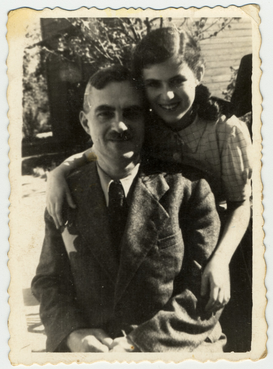 Close-up portrait of a Jewish father and his daughter wearing yellow stars in a rest home in the Marysin colony of the Lodz ghetto.  Pictured are Gustaw and Inka Gerson.