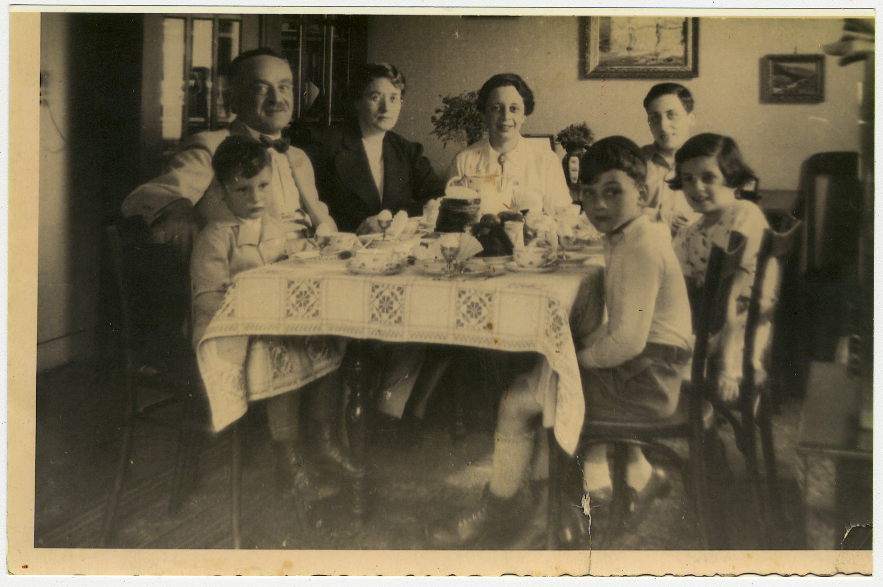 A German-Jewish father and his two sons visit with Belgium relatives.  Pictured in the left front are Manfred and Alfred Manasse.  Opposite them is Gustav Manasse.