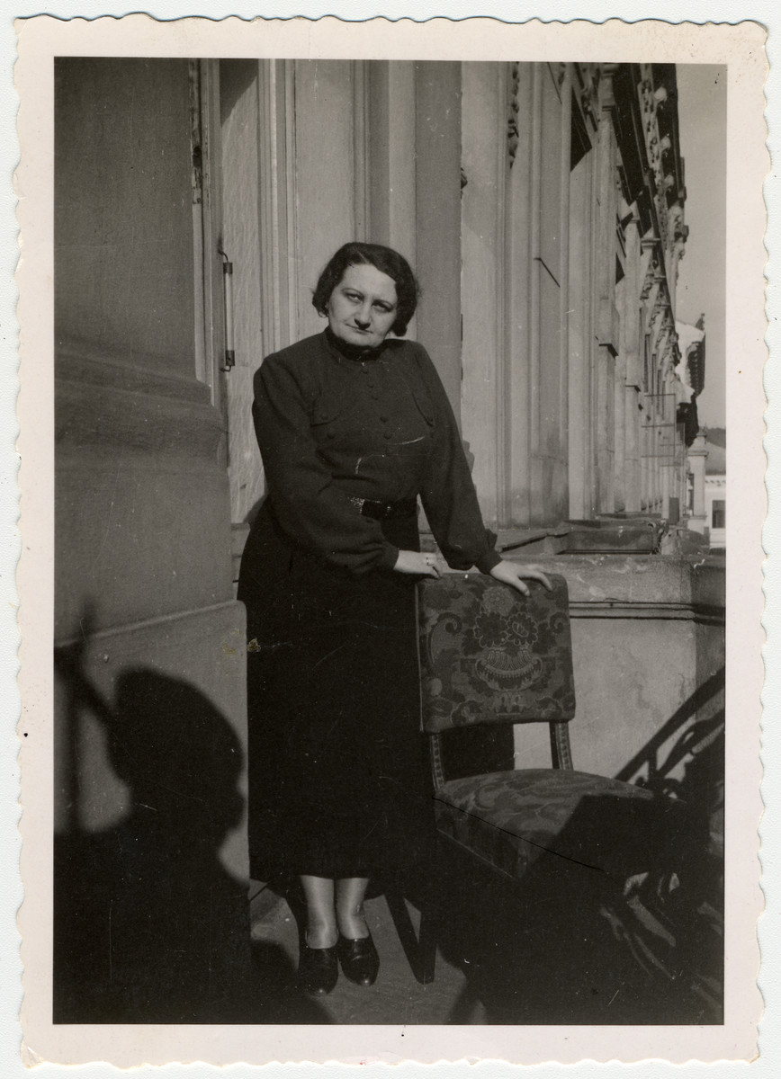 Lily Brod. a Hungarian Jewish woman leans against a chair on the porch of her uncle's home in Budapest.