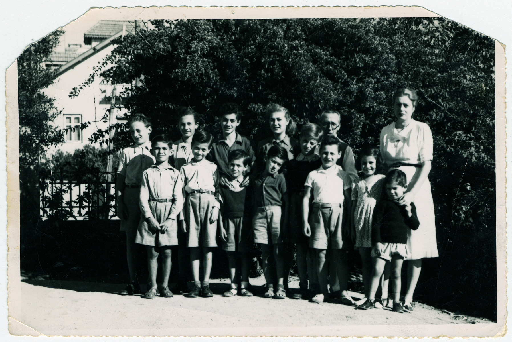 Group portrait of Jewish children  waiting to immigrate to the United States.  Manfred Manasse is pictured in the front row, second from the right.  His brother Gustav is pictured in the second row on the far left.