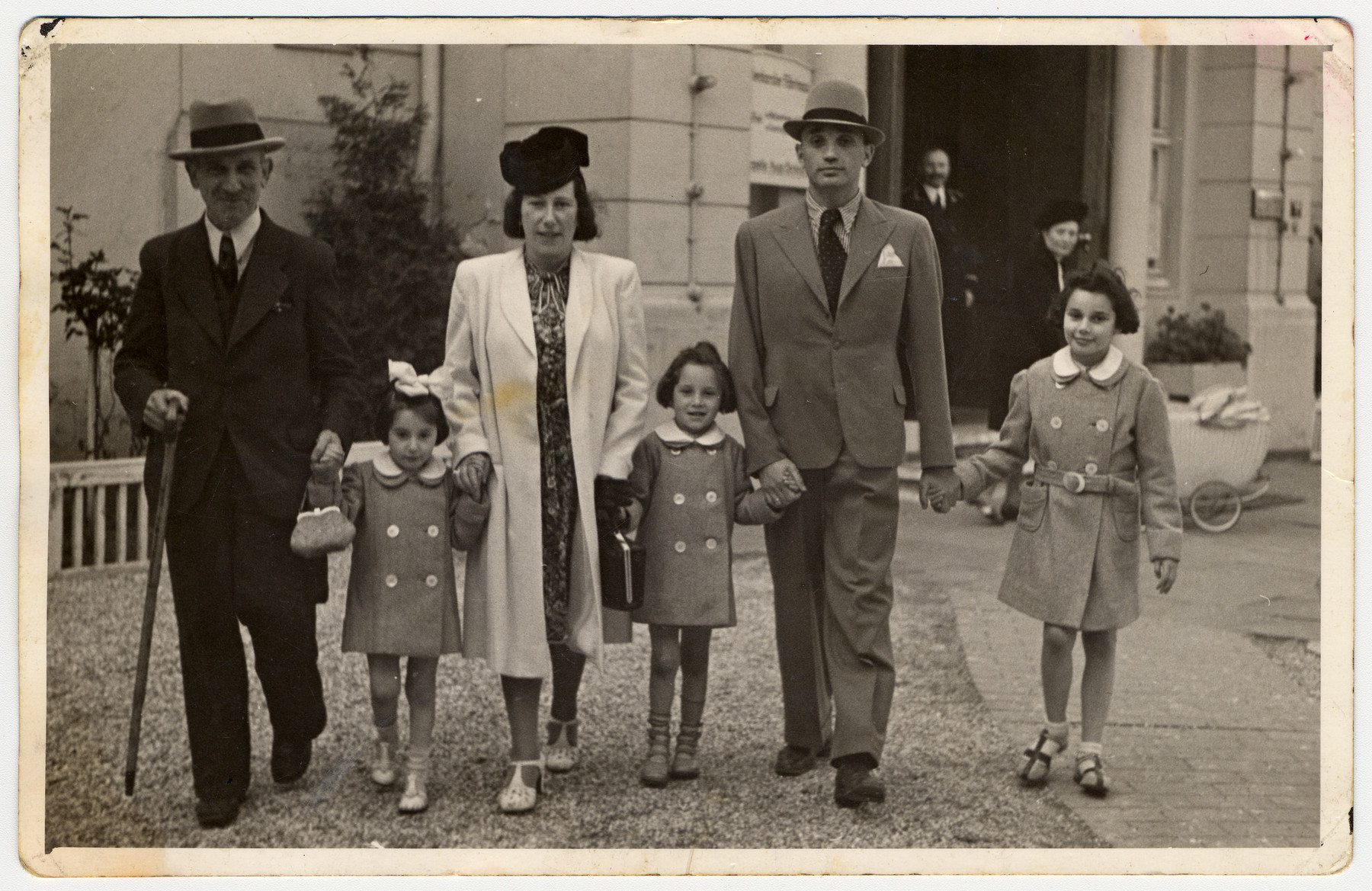 A German-Jewish family walks down a street in Hamburg prior to its departure for America.  From left to right are Wilhelm Jotkowitz, Renate, Edith, Karen, Werner and Marion Gumprecht.  Wilhelm Jotkowitz, Edith's father, was unable to leave with the others and later perished in the Mintz ghetto.