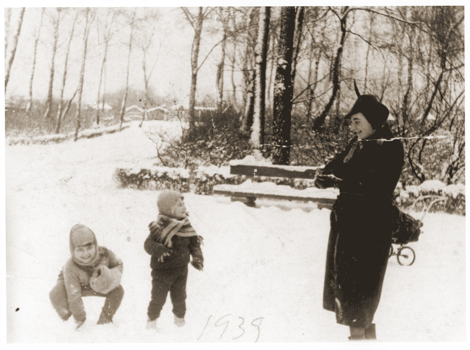 Salusia and Wolf Goldblum play in the snow with their nanny in Katowice.