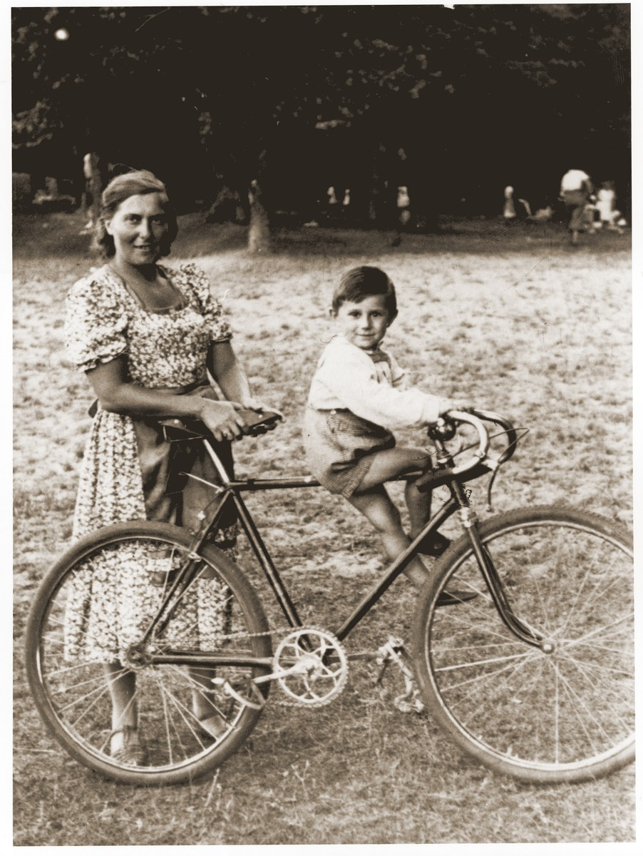 Tola Goldblum takes her son Wolf for a bicycle ride while on vacation in Zarki.