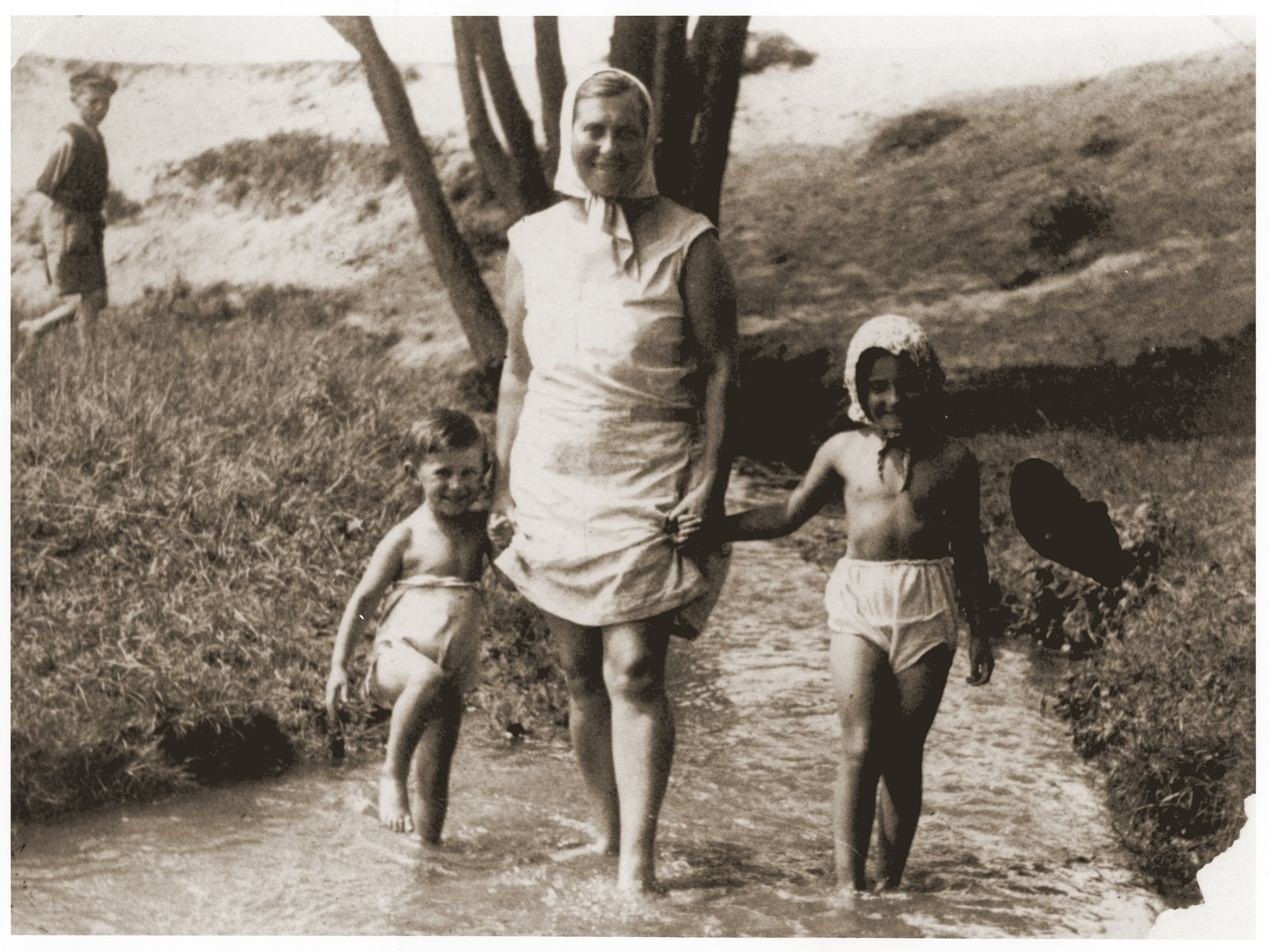 A Jewish mother wades in the water with her two young children while vacationing in Zarki.  Pictured are Tola Goldblum with her children Salusia and Wolf.