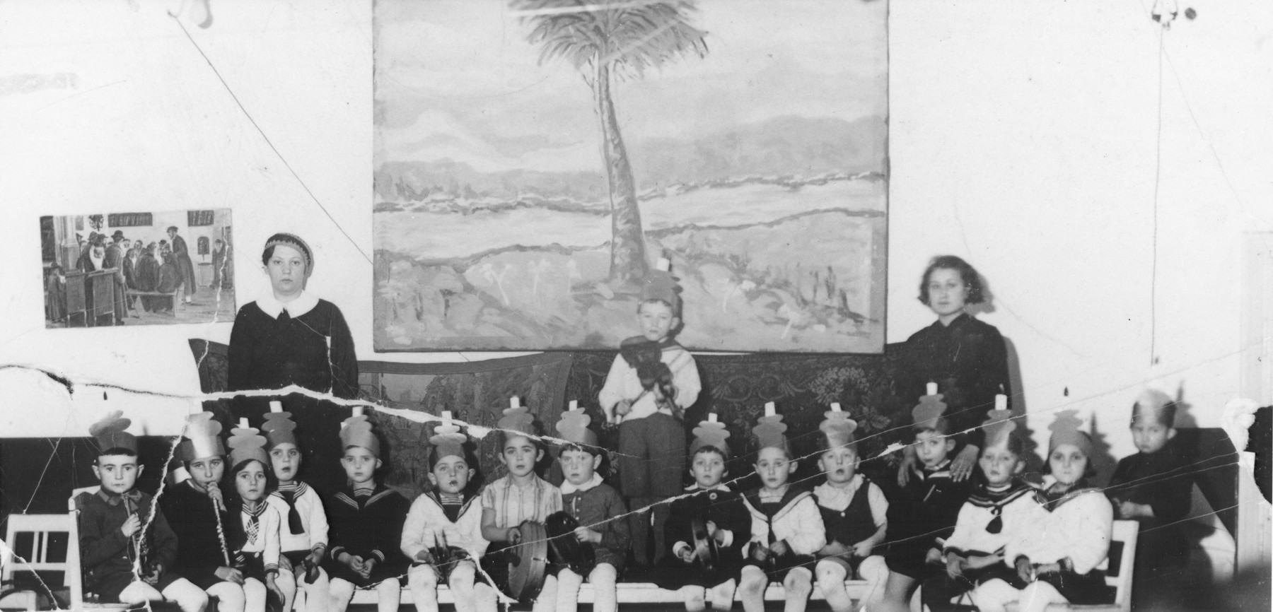 Students in a Jewish kindergarten in Kovno.  Helen Verblunsky is seated seventh from the left in the striped shirt.