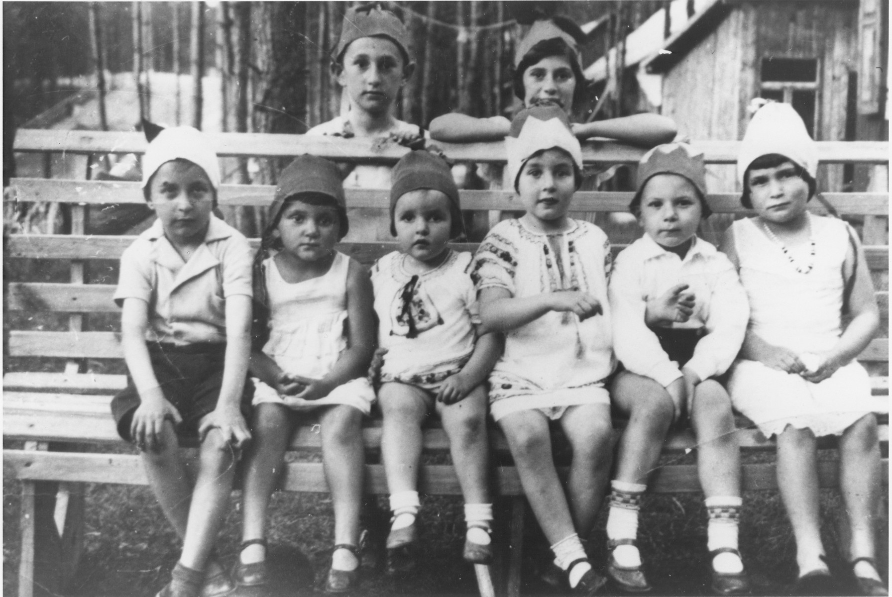 First graders in the Hebrew Gymnasium in matching hats.    Zev Birger is on the far left.