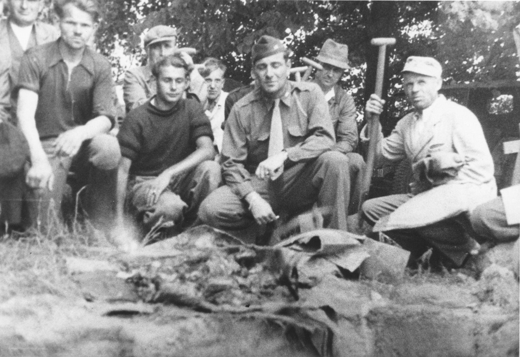 American soldiers examine the exhumed remains of the Polish and Soviet infants who died in the nursery in Ruehen.