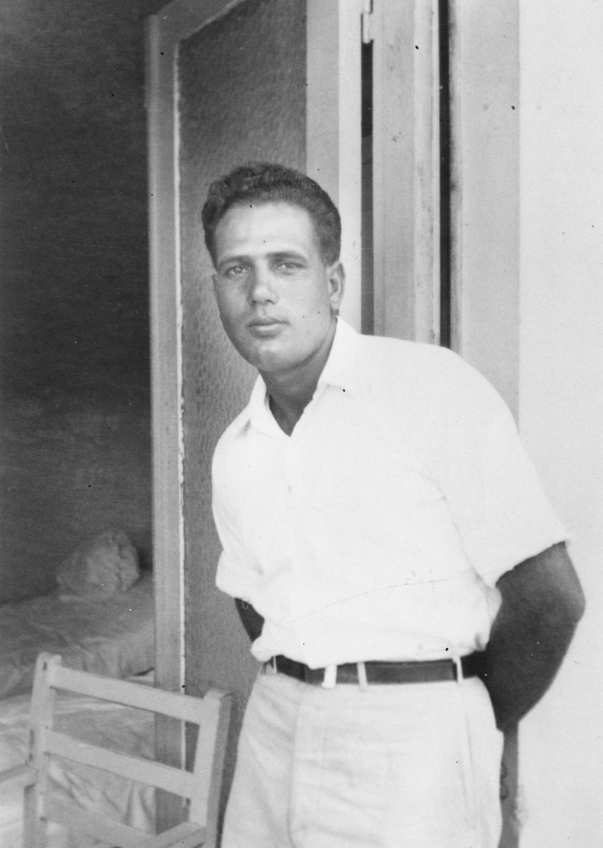 Portrait of Exodus 1947 crew member Aryeh Friedman, standing in the doorway of a Haifa hotel on Mt. Carmel after being released from British custody.  Friedman later captained the Aliyah Bet ship Haganah.