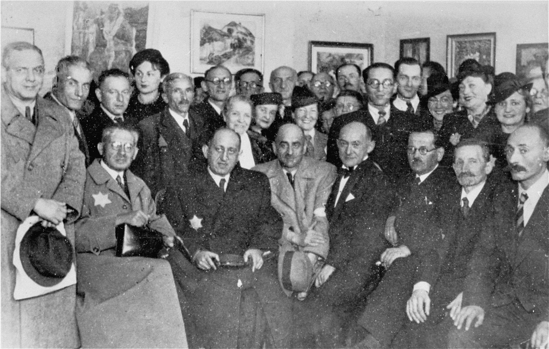 Group portrait of members of the Lodz ghetto administration at a cultural event in the ghetto.  Among those pictured are Leon Rozenblat (seated, third from the left) and Dr. Leon Szykier (seated second from the left).