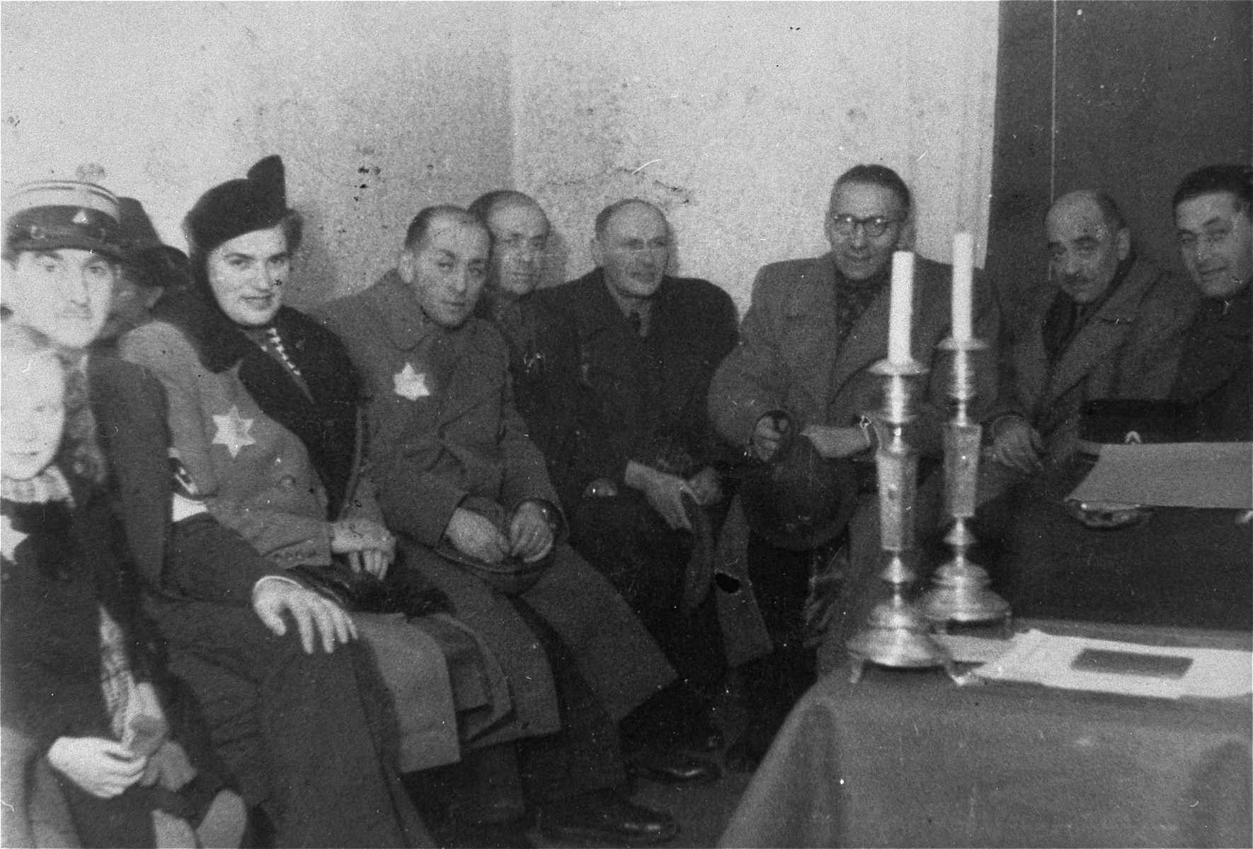 Social gathering in the Marysin police station in the Lodz ghetto.    Among those pictured are Zeligman (first on the left) and Leon Rozenblat (second from the right).  Baruch Braszker is fourth from the left and [Uberbaum is on the far right.]