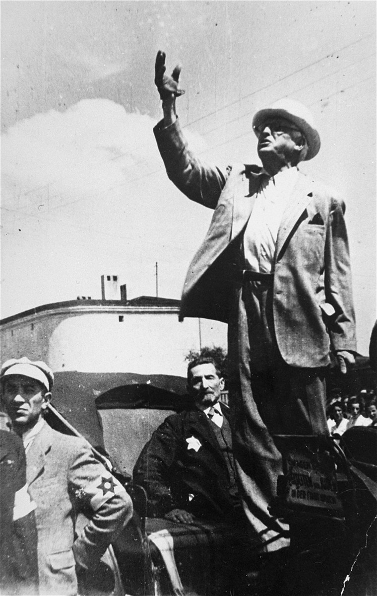 Mordechai Chaim Rumkowski, chairman of the Jewish council delivers a speech from his carriage.