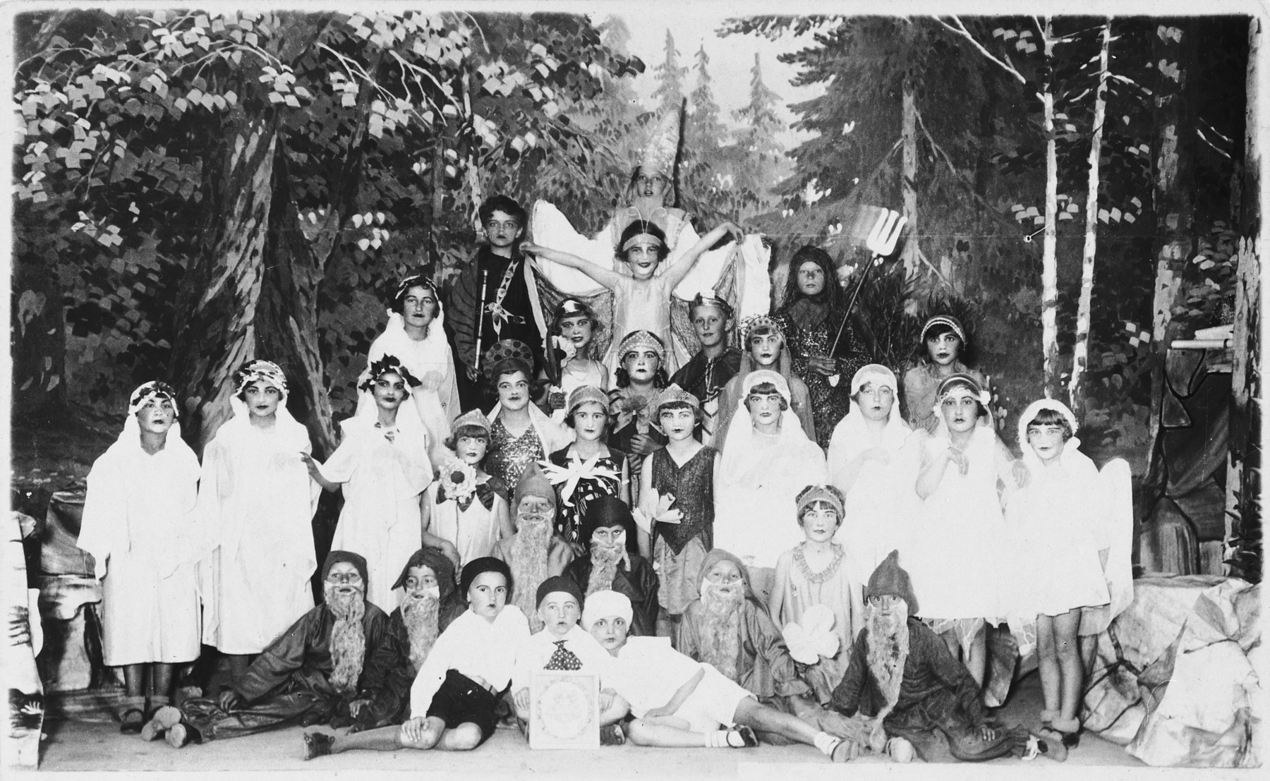 Group portrait of children in a school performance in Tacovo.  Among those pictured is Goldie Berger (center).