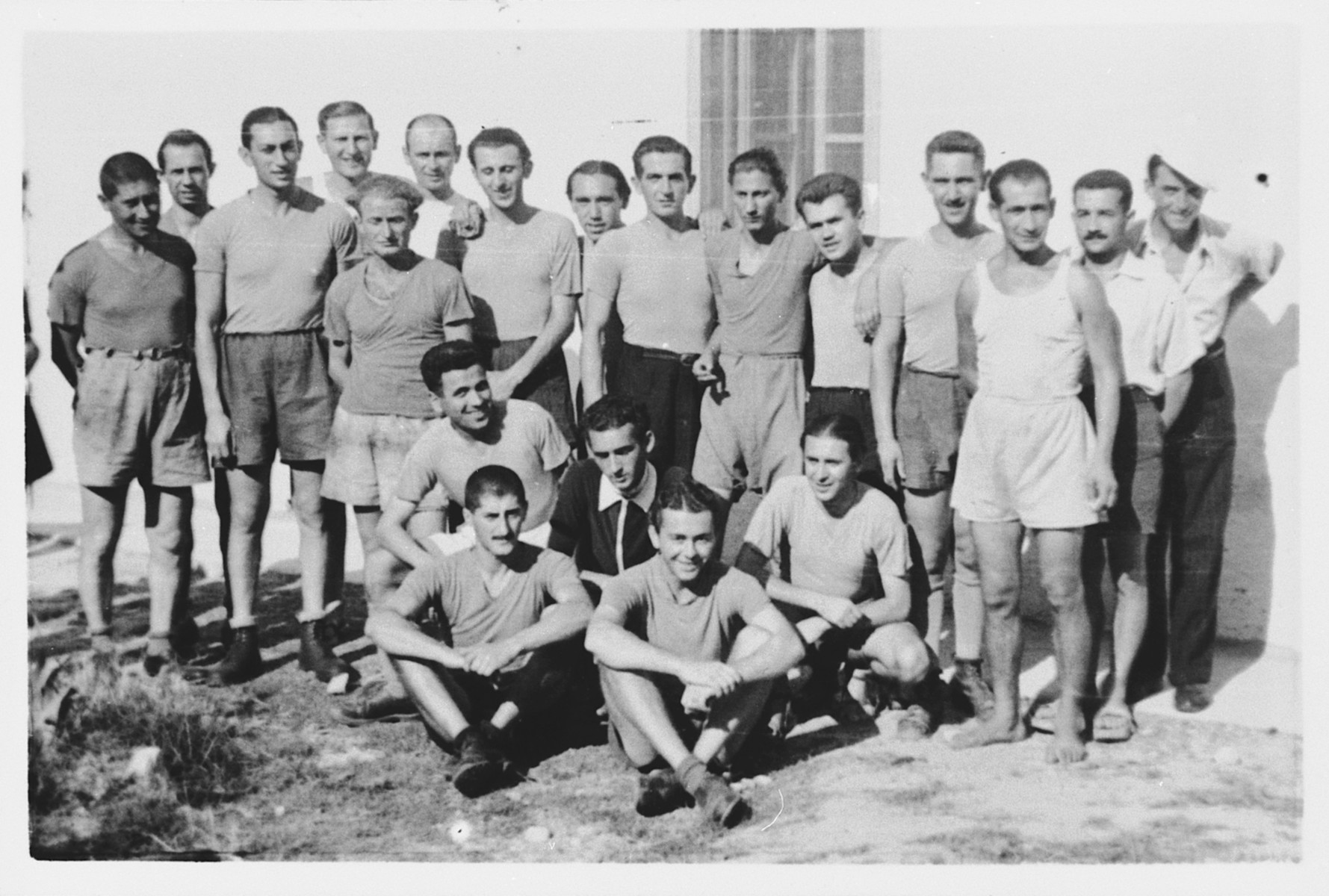 Group portrait of a soccer team in the Ferramonti camp.  This photograph was taken during a visit by Rabbi Pacifici to the internees.