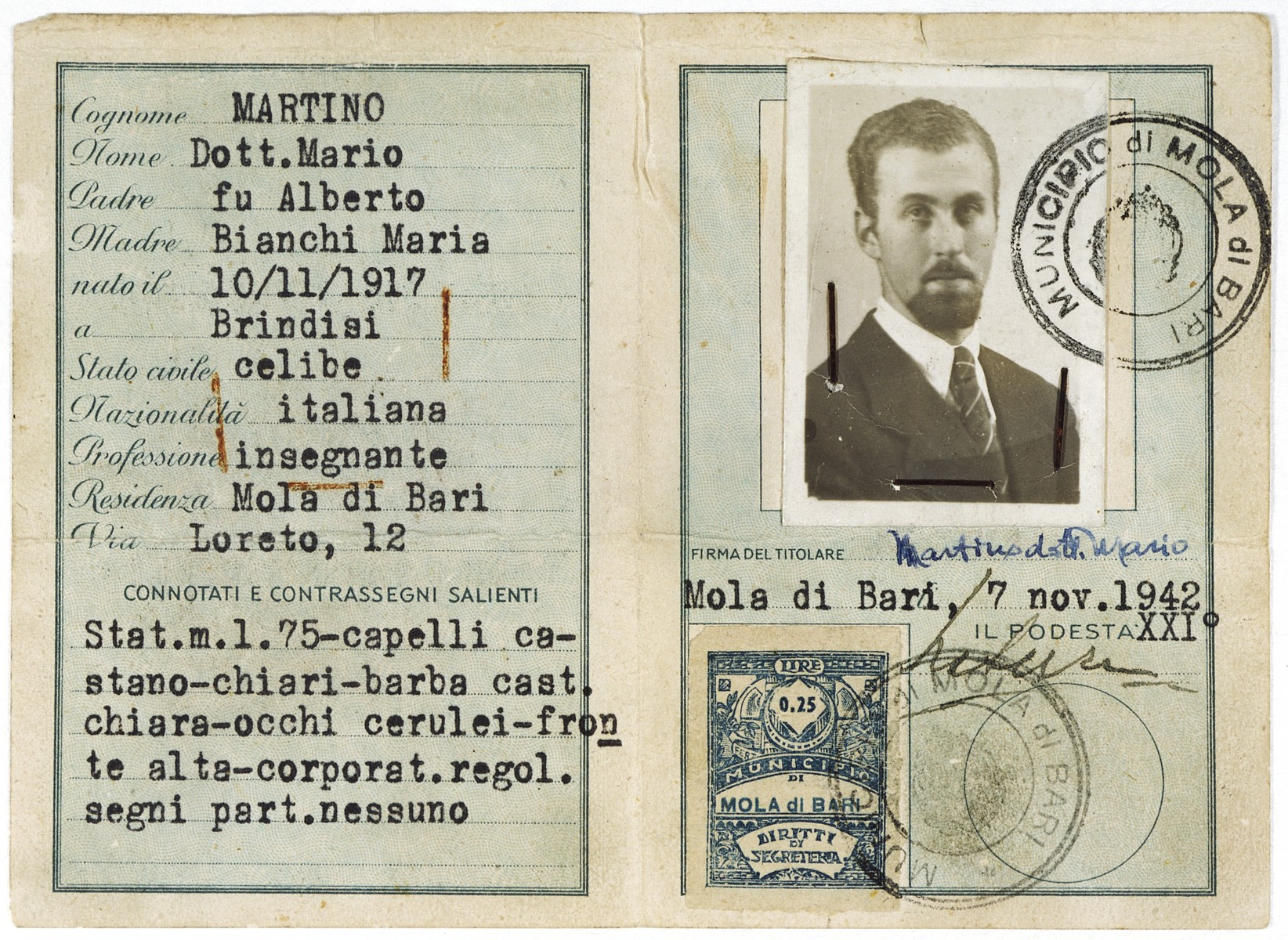 False identification card issued to the Italian Jew, Marcello Morpugo, who was living under the alias of Mario Martino during the German occupation of Italy.  Morpugo grew a beard to help disguise his identity.