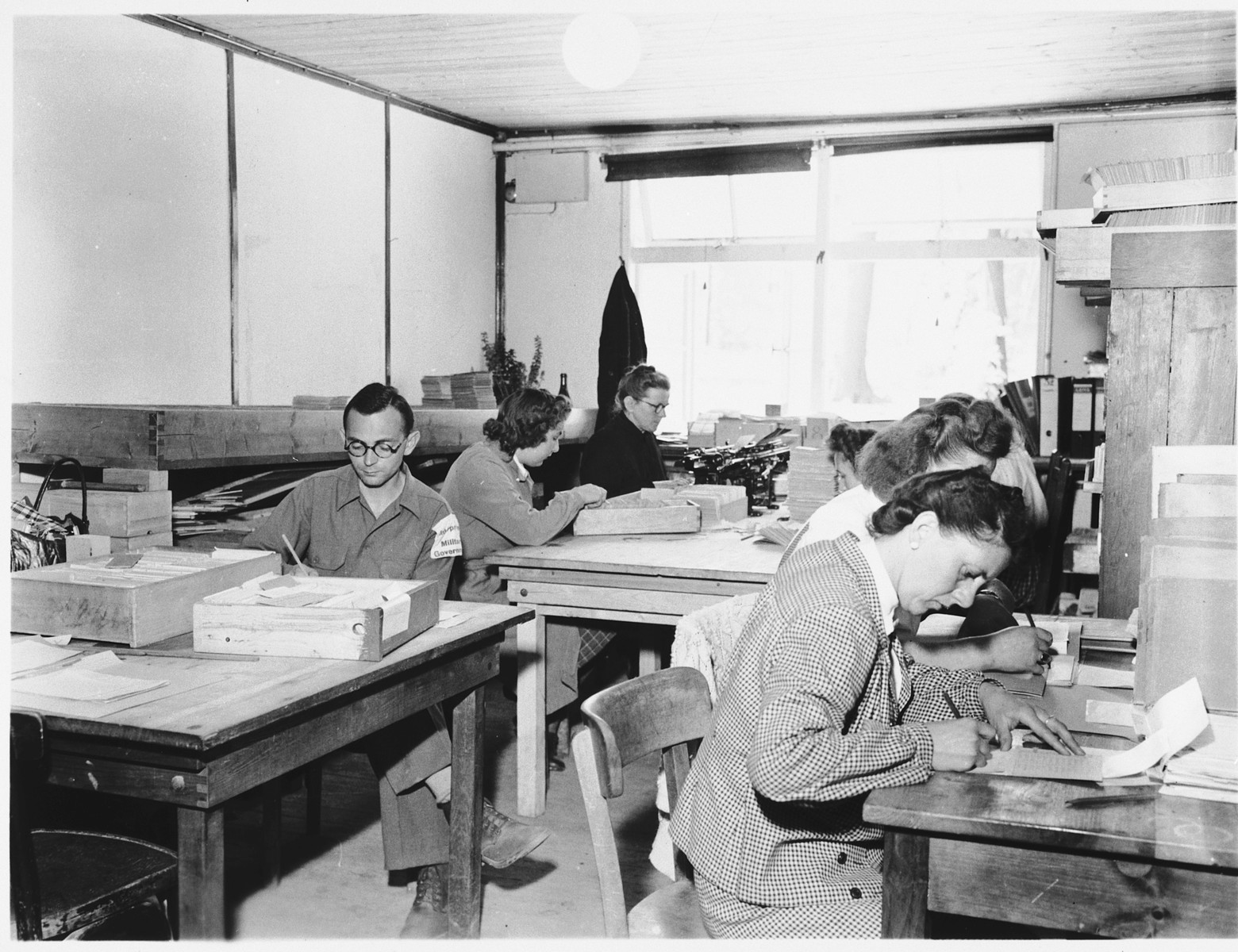 Men and women at work in the war crimes commission office established in Buchenwald.