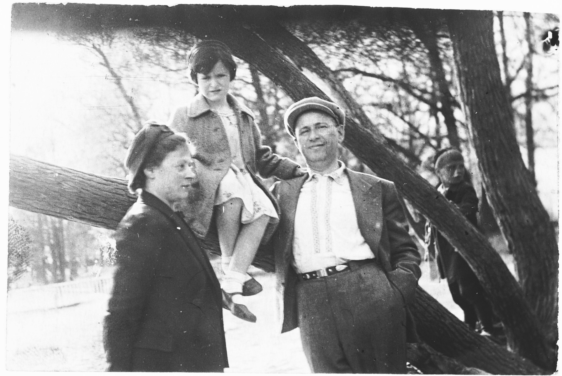 Portrait of the Schneidman family on an excursion to a park in Leningrad.  From left to right are Maria, Galina and Ilya Schneidman.