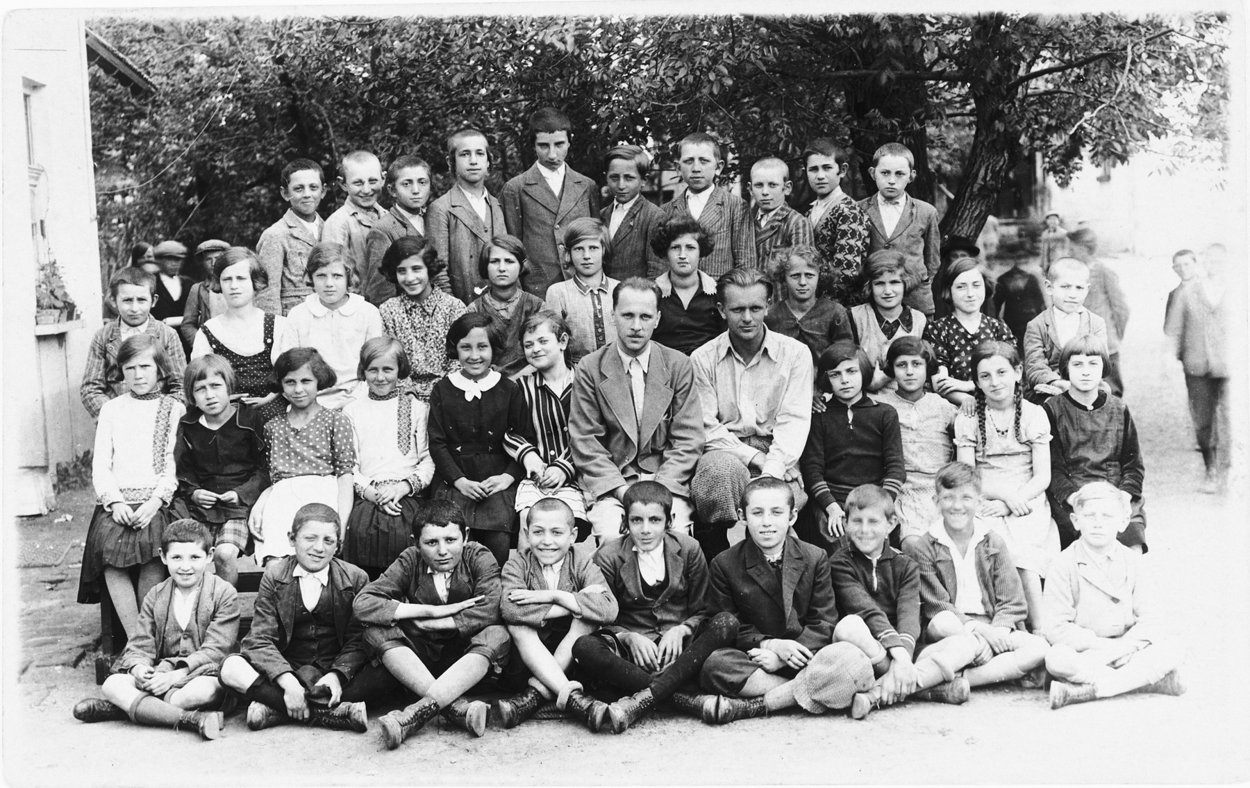 Group portrait of students and teachers at a public school in Tacovo.  Among those pictured is Goldie Berger (second row from the front, fourth from the right).