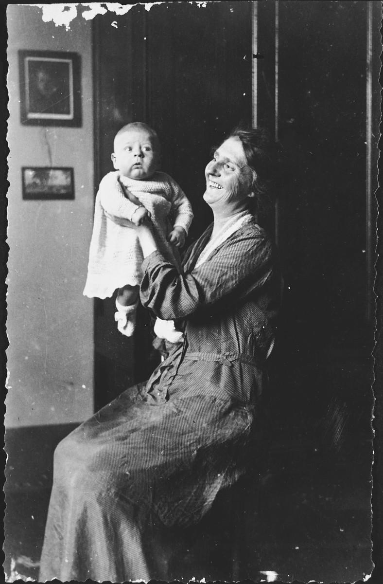 Linda Abenaim holds her young grandson, Emanuele Pacifici.