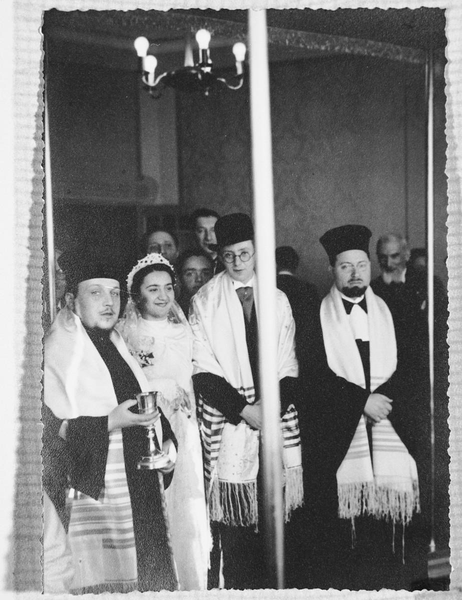 Rabbi Riccardo Pacifici officiates at the wedding of Regina and Guido Sacerdoti.